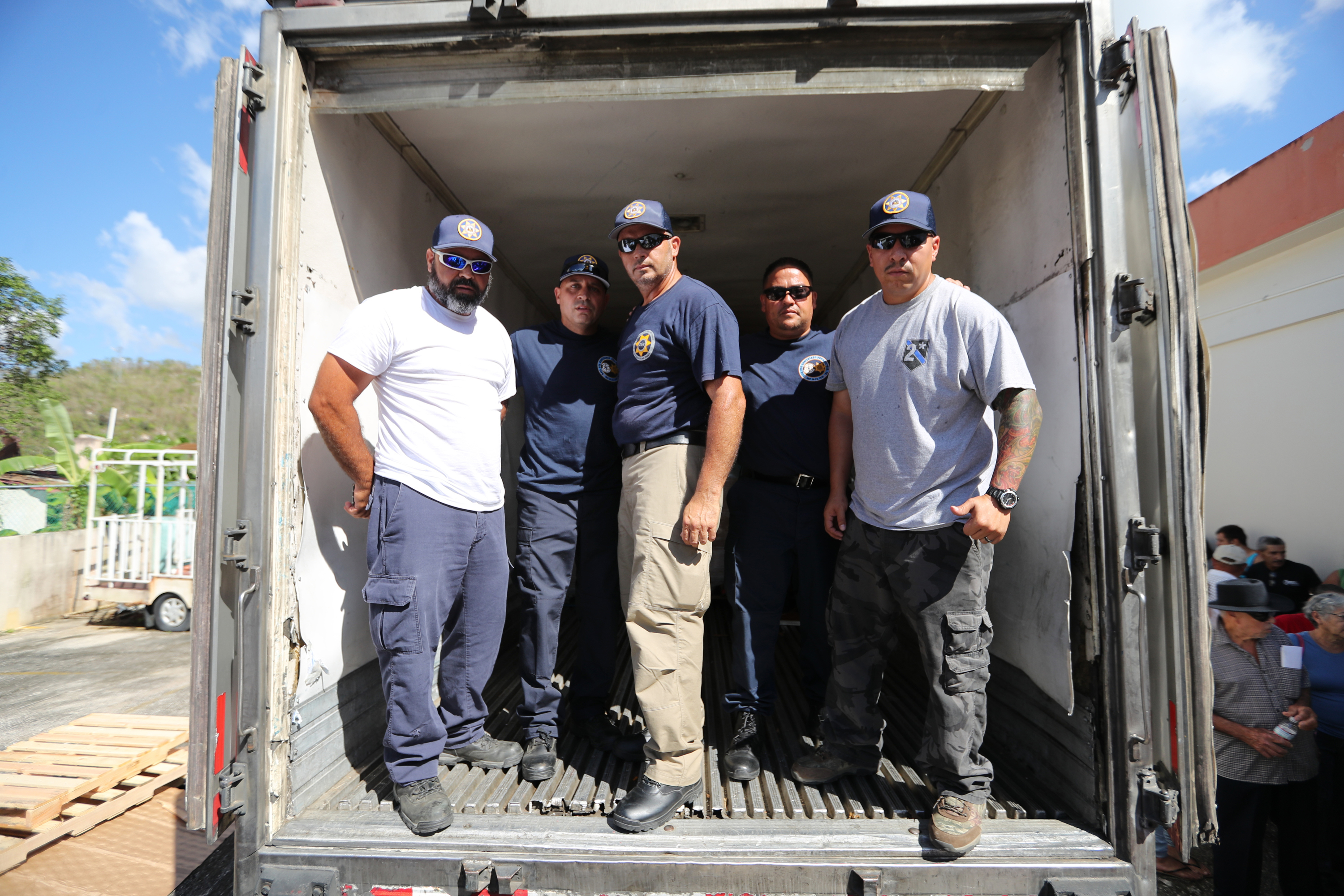 Emilio Sanchez, from PECO, Josh Perez, Mike Bastone, Tito Carrasquillo and Rick Marin of the Philadelphia Sheriff´s Office, who volunteered with the American Red Cross, delivered water and food in Florida, Puerto Rico, Wednesday October 1, 2017.
