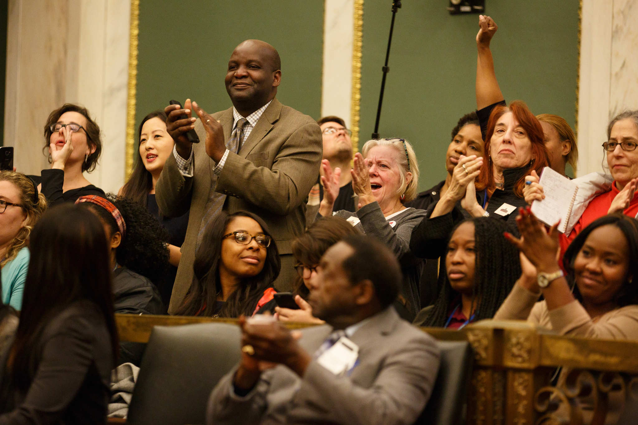 The crowd applauds after Mayor James Kenney announces that the 16-year SRC experiment is ending in City Council Chambers, in Philadelphia, Thursday, Nov. 2, 2017.