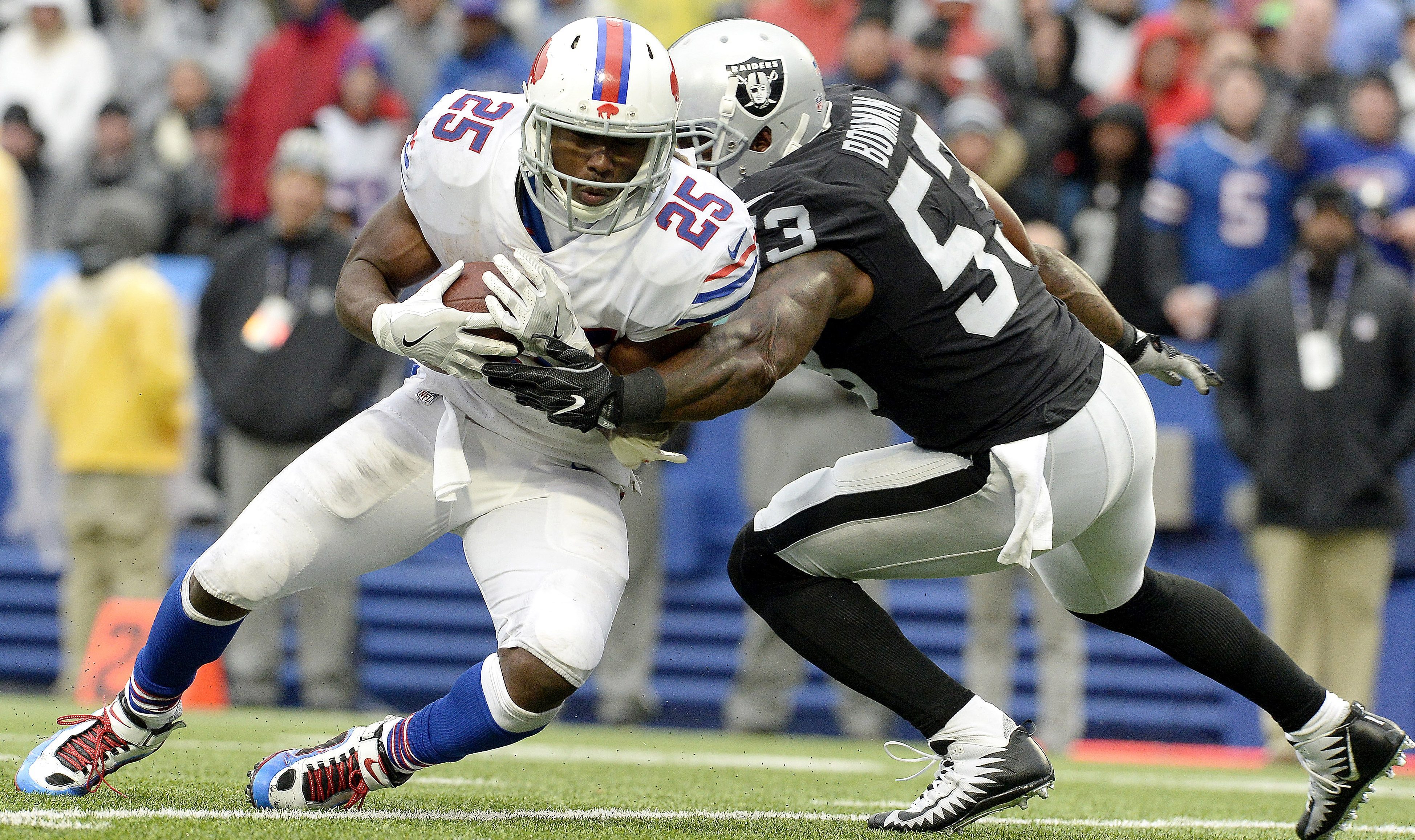 Buffalo Bills running back LeSean McCoy (25) is tackled by Oakland Raiders middle linebacker NaVorro Bowman (53) during the second half of an NFL football game, Sunday, Oct. 29, 2017, in Orchard Park, N.J. (AP Photo/Adrian Kraus)