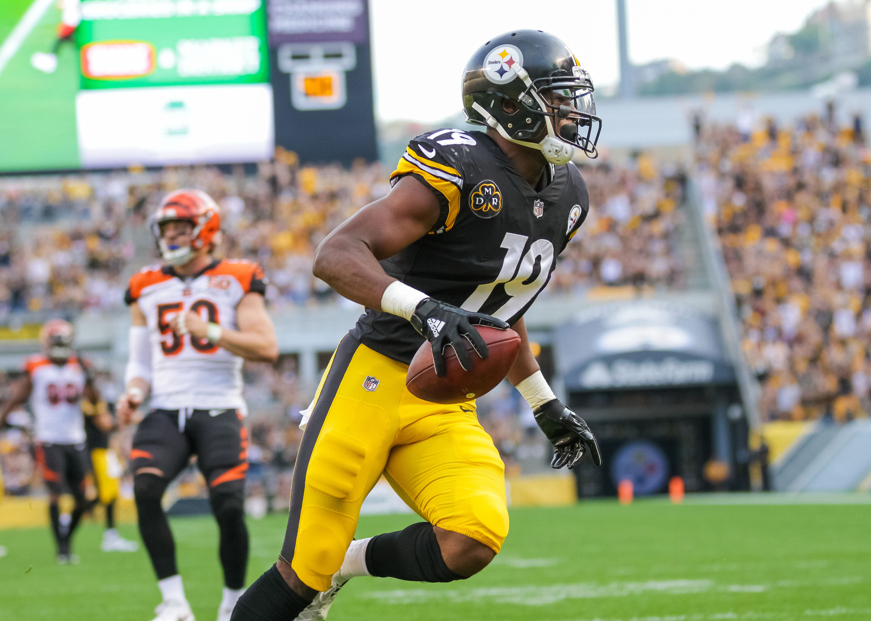 Pittsburgh Steelers wide receiver JuJu Smith-Schuster, shown here scoring one of his four touchdowns this season, has been a popular pickup this week among fantasy football players. (Brian Kunst/Zuma Press/TNS)