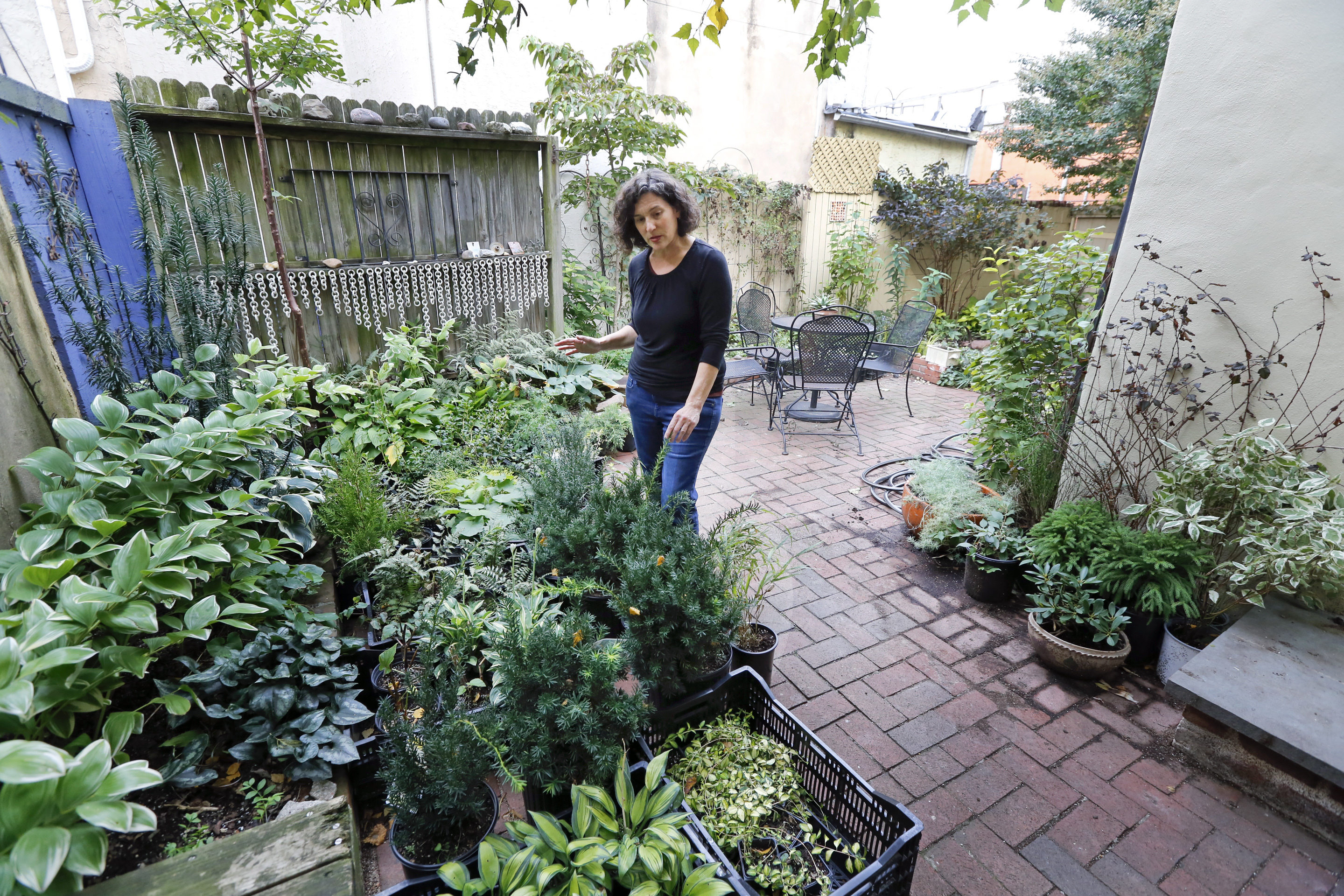 Airbnb host Carrie Borgenicht, on the patio at her South Philadelphia home. She says the income helped her start an urban gardening business.