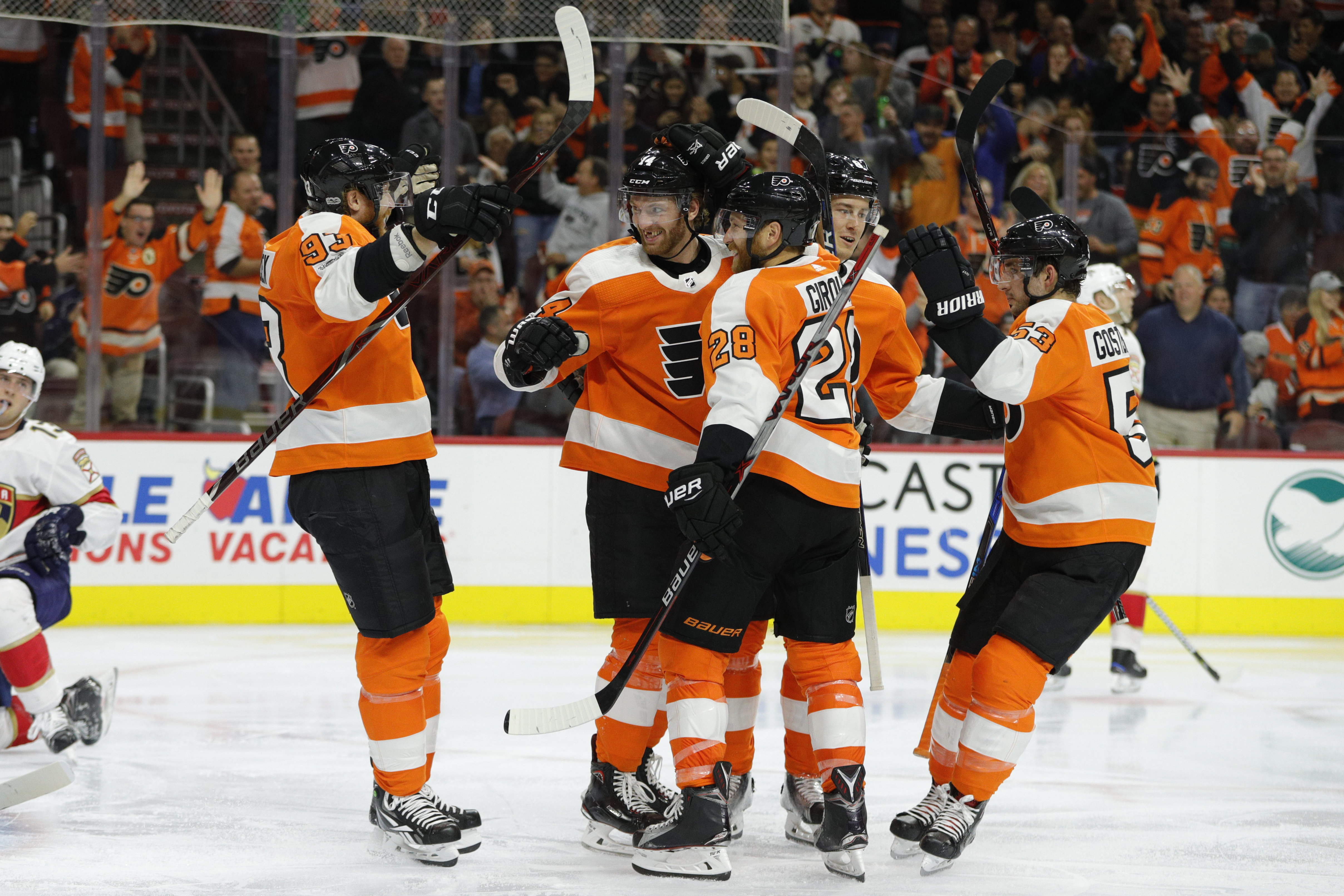 Flyers center Sean Couturier celebrates a goal with teammates on Oct. 17.