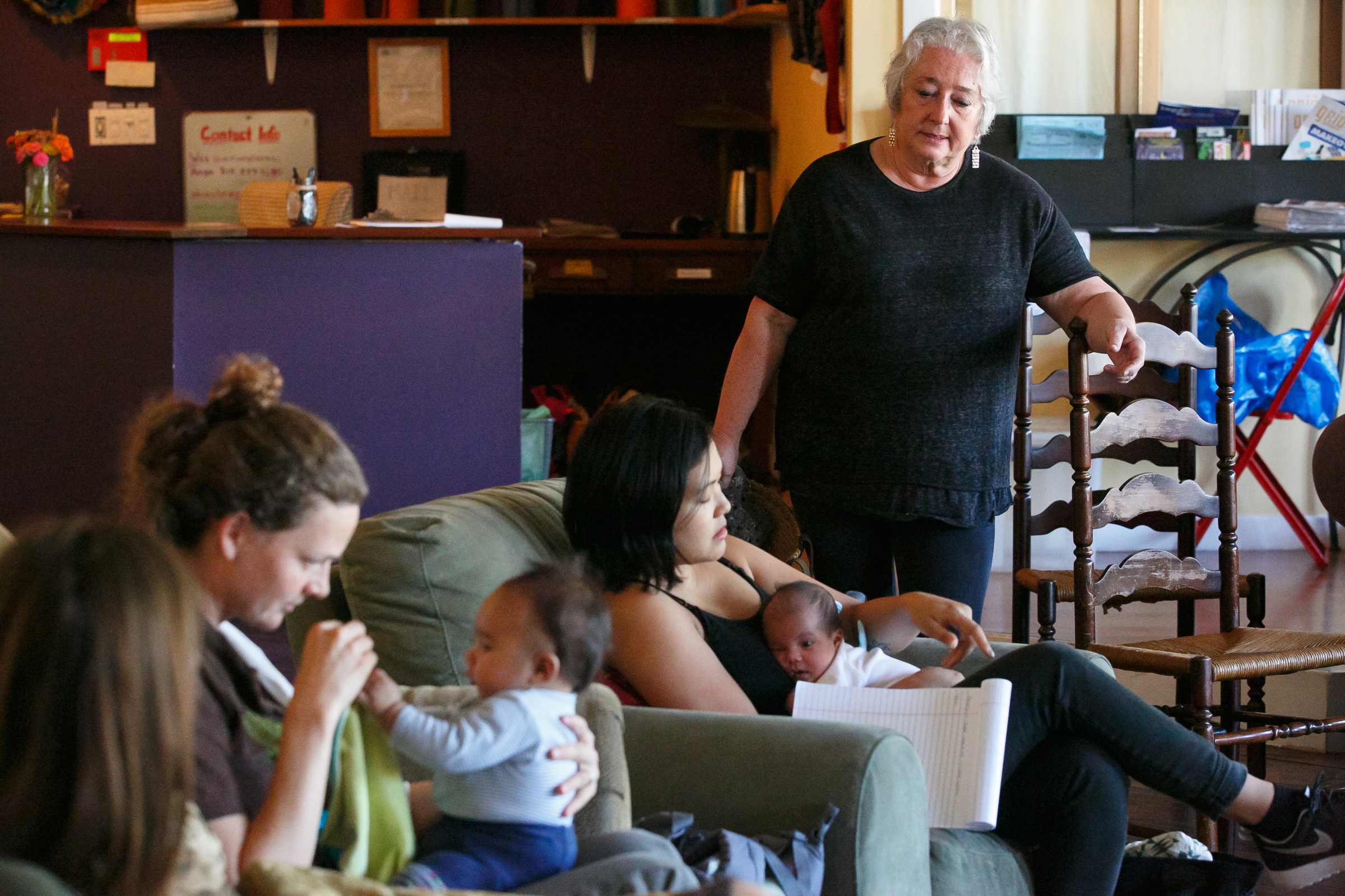 Veteran lactation consultant Patty Siegrist, standing right, leads a breastfeeding support group.