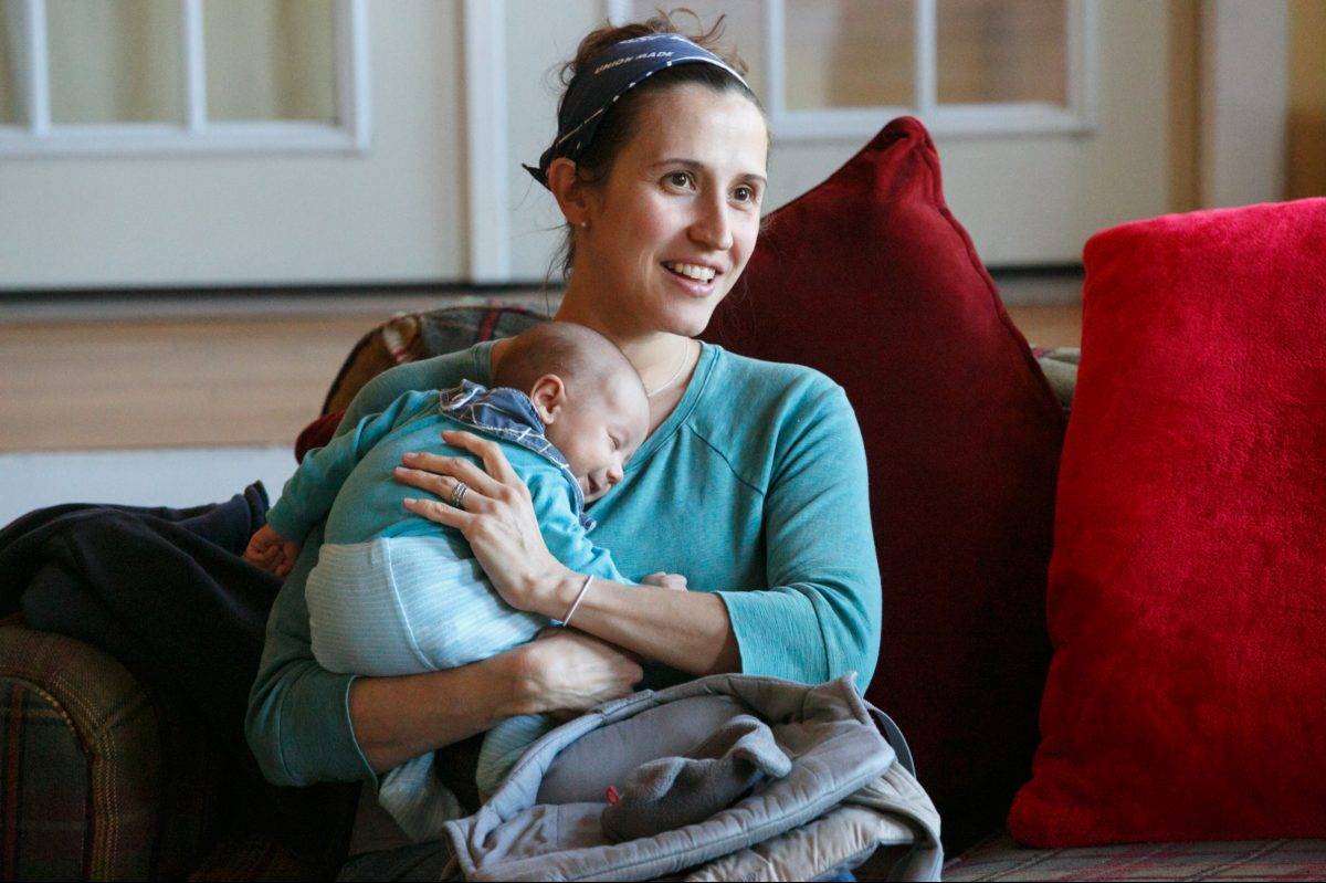 Lara Kalin holds her daughter Charlie at a breastfeeding support group meeting.