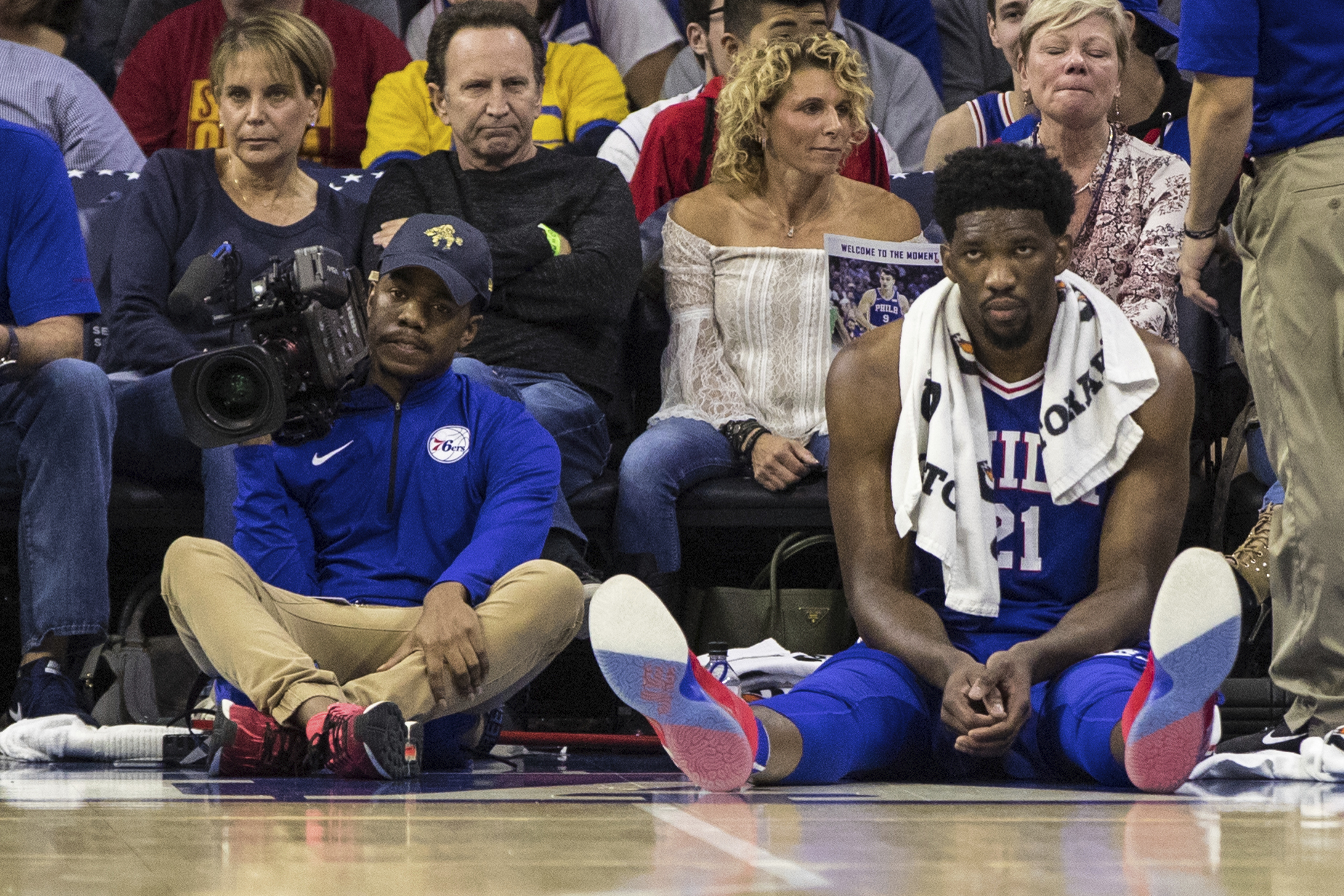 Philadelphia 76ers´ Joel Embiid, of Cameroon, looks on from the sidelines during the first half of an NBA basketball game against the Indiana Pacers, Friday, Nov. 3, 2017, in Philadelphia. The 76ers won 121-110. (AP Photo/Chris Szagola)