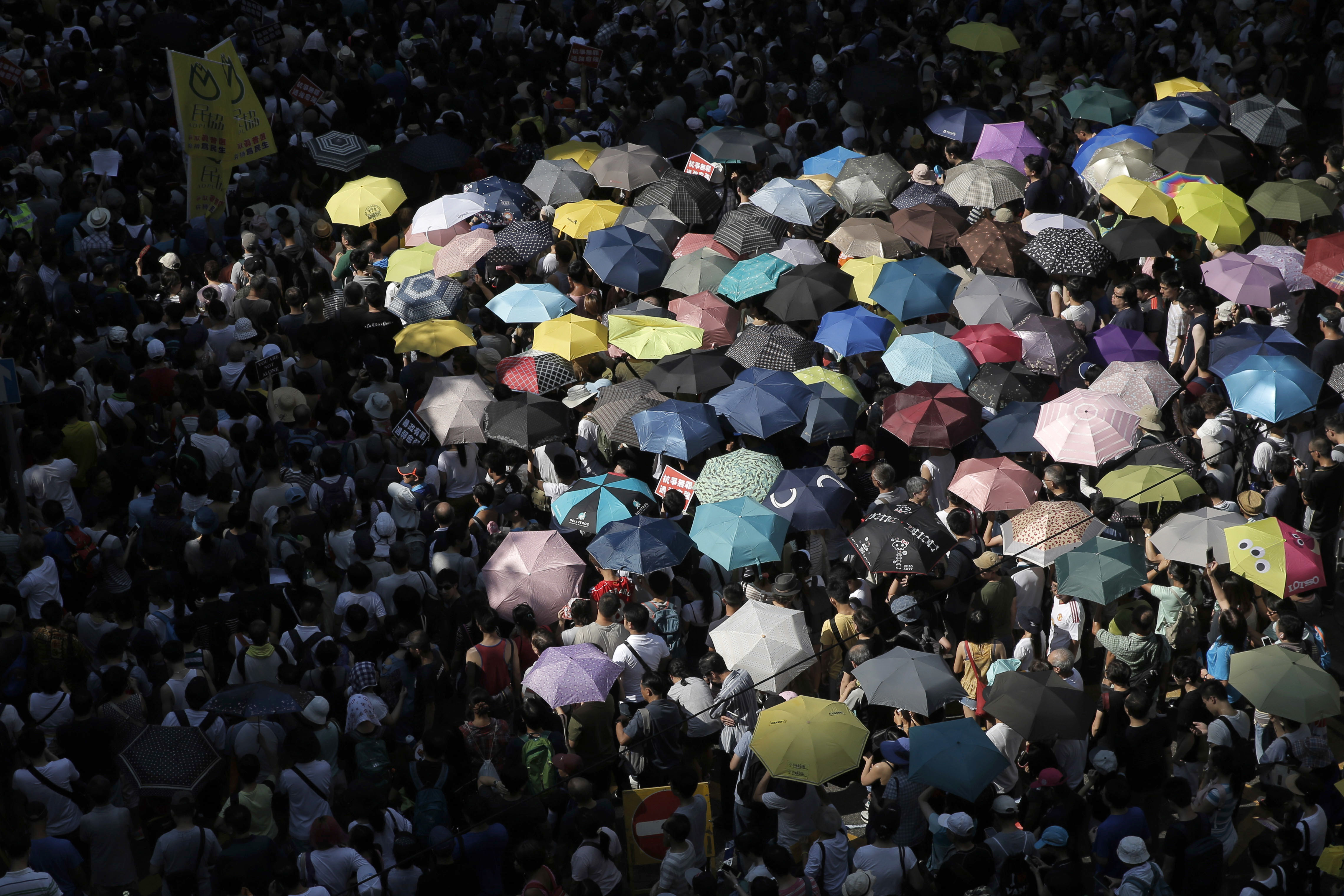 Protesters attend a rally to support young activists Joshua Wong, Nathan Law and Alex Chow in downtown Hong Kong on Aug. 20, 2017.