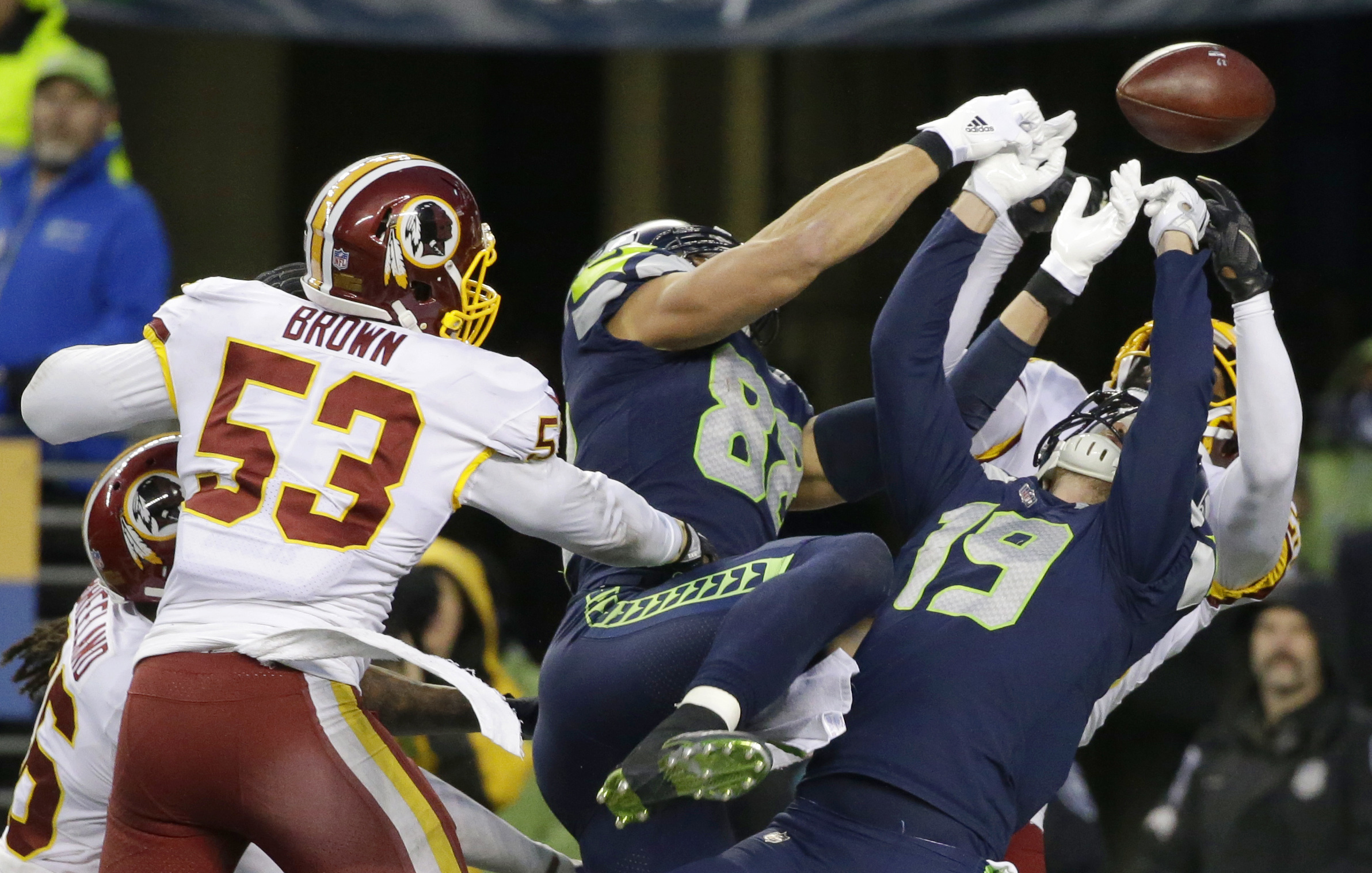 Washington Redskins free safety DeAngelo Hall, right obscured, and inside linebacker Zach Brown (53) break up a pass as Seattle Seahawks tight end Jimmy Graham (88) and wide receiver Tanner McEvoy (19) reach for the ball late in the second half of an NFL football game, Sunday, Nov. 5, 2017, in Seattle. Washington won 17-14. (AP Photo/Stephen Brashear)