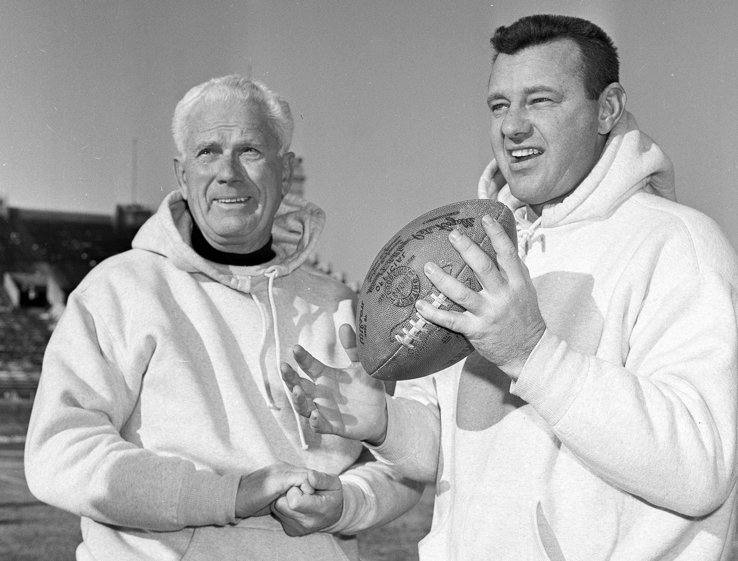 Eagles quarterback Norm Van Brocklin, poses with coach Buck Shaw during a workout in December 1960, in preparation for the title game against the Green Bay Packers.