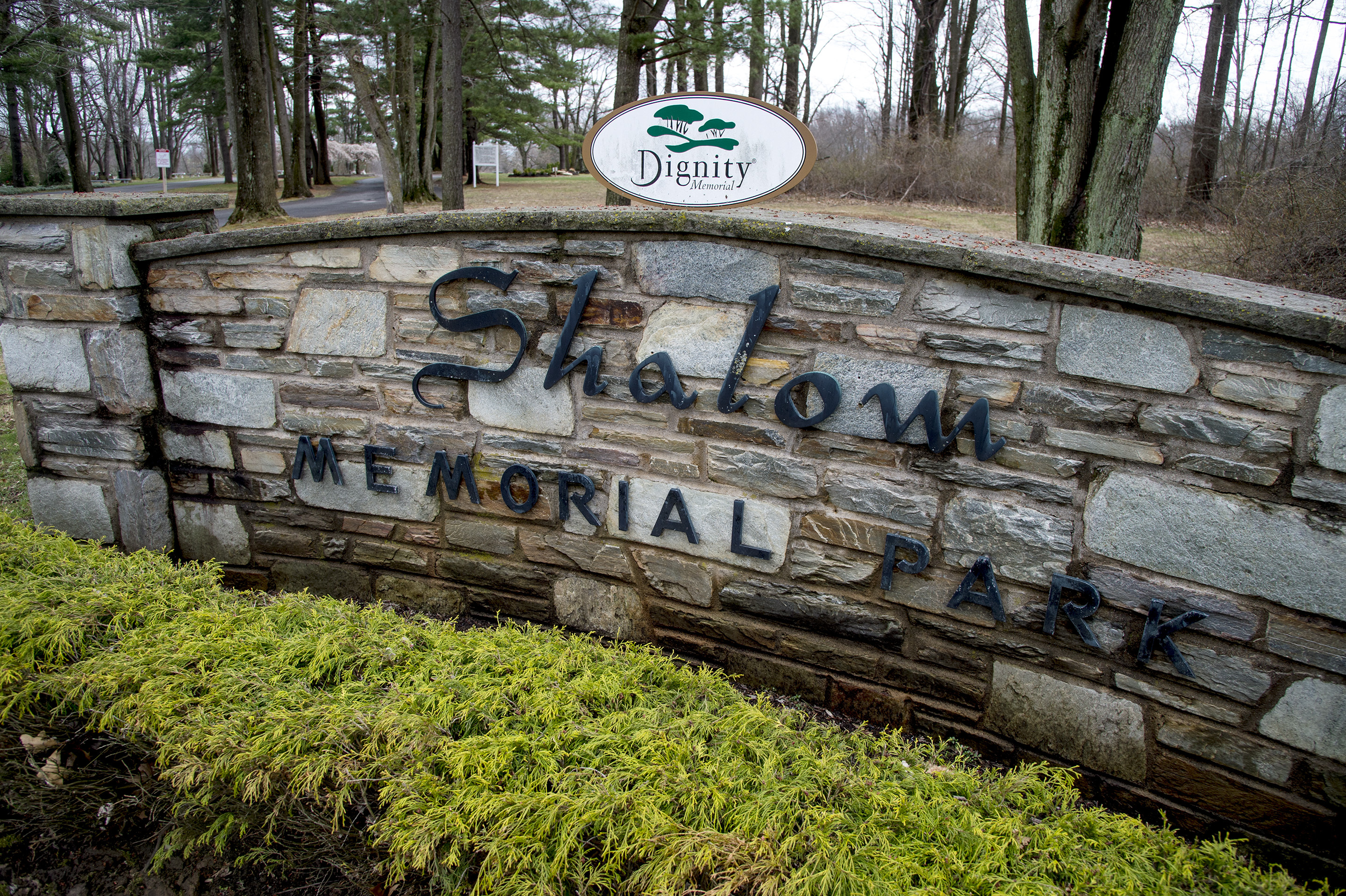 The entrance to Shalom Memorial Park off of Pine Road in Huntingdon Valley April 4, 2017. David Waxler's mother and father are buried in the cemetery. He was told shortly before his mother Edna's burial in June 2016 that the workers for the owners of the cemetery, Houston-based Service Organization International under the name Dignity Memorial, found a casket already in the space, next to his father's casket, where his mother was to be buried. There have been other complaints from relatives of loved ones who are buried in the cemetery. CLEM MURRAY / Staff Photographer