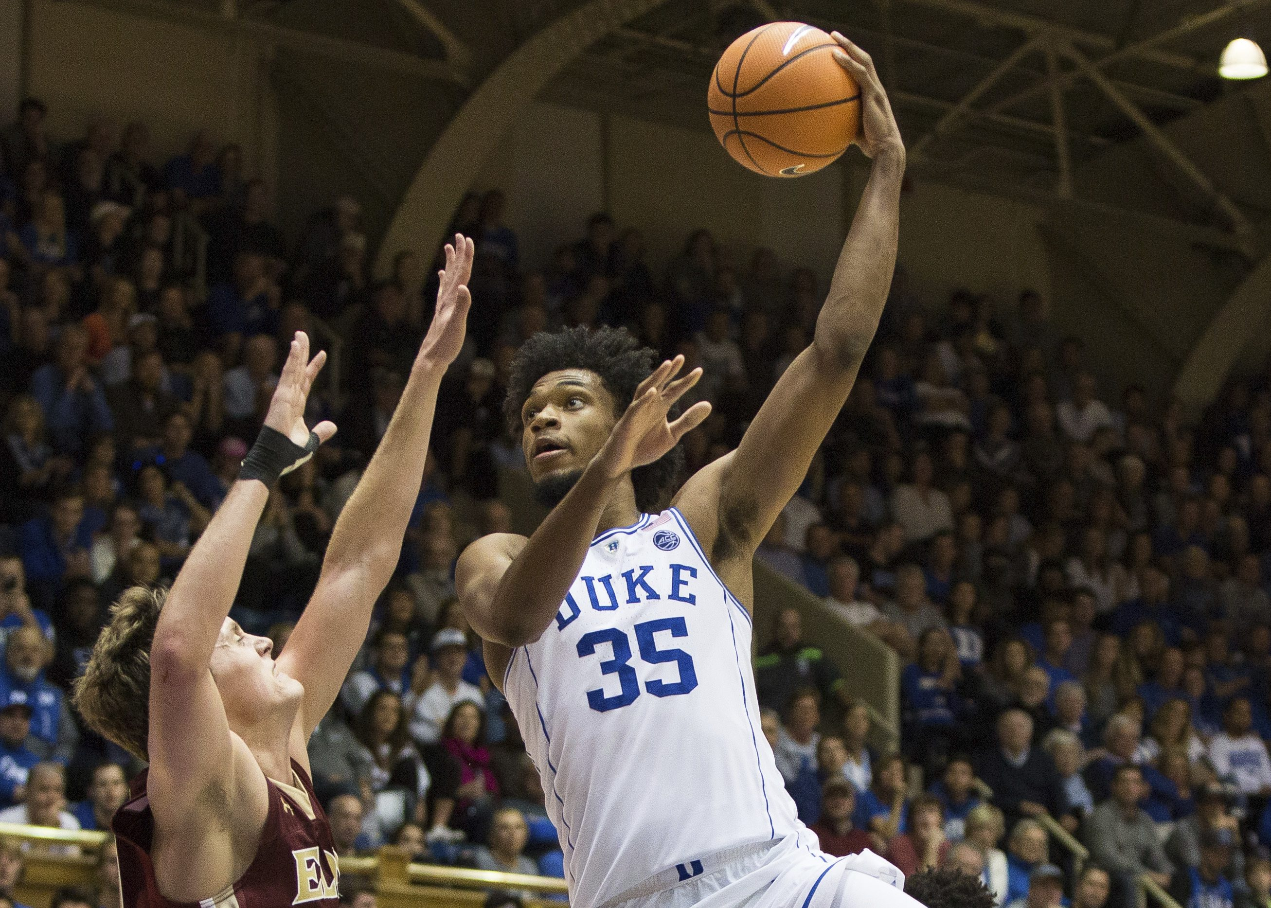 Duke's Marvin Bagley III (35) attempts a shot over Elon's Tyler Seibring, left, during the second half of an NCAA college basketball game in Durham, N.C., Friday, Nov. 10, 2017. Duke defeated Elon 97-68. (AP Photo/Ben McKeown)