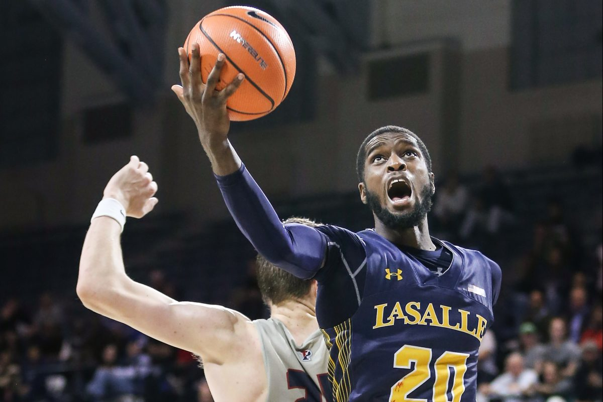 La Salle´s B.J. Johnson grabs a loose ball over Penn´s AJ Brodeur during the first overtime Monday night.