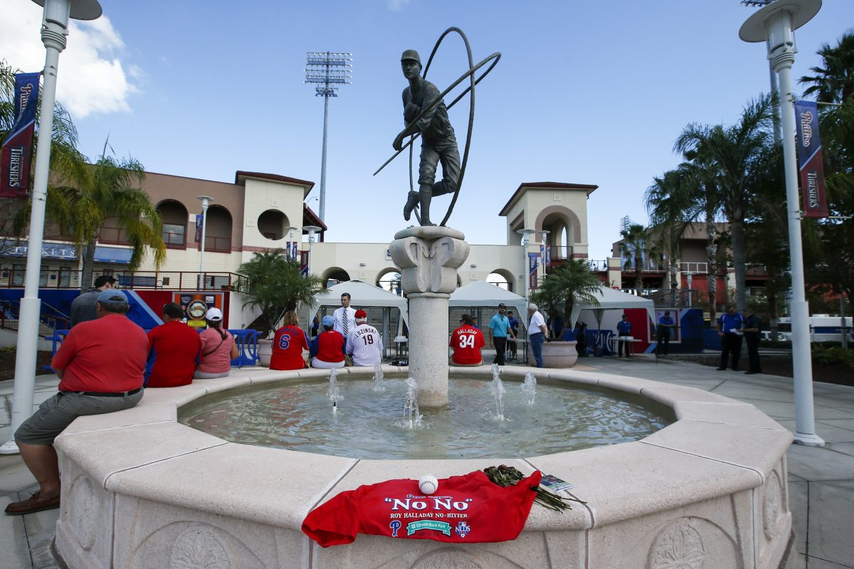 Fans wait outside Spectrum Field in Clearwater, Fla., before the start of the celebration of life for Roy Halladay.
