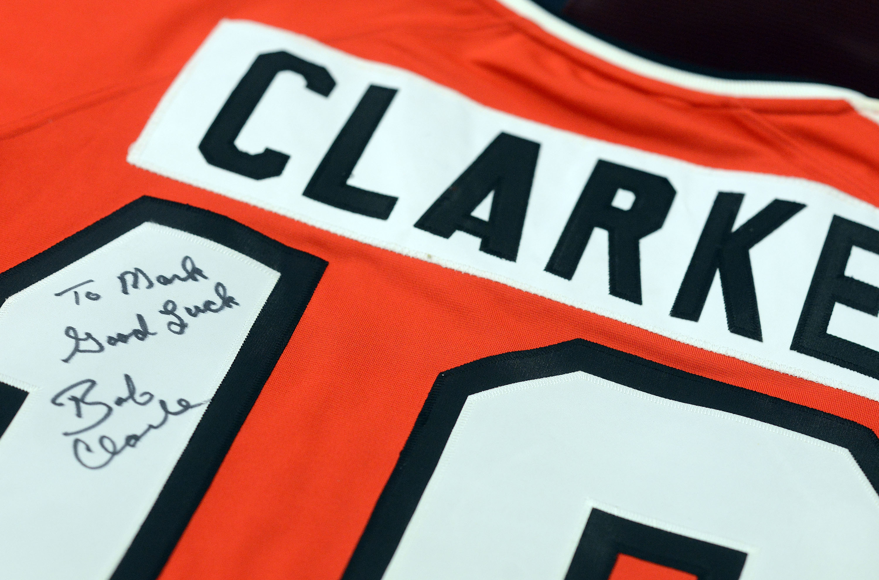 A signed Bobby Clarke Philadelphia Flyers jersey is up for bidding during the online auction of some sports memorabilia, most of which came from Mark Begley, a Cherry Hill man arrested for mortgage fraud two years ago.