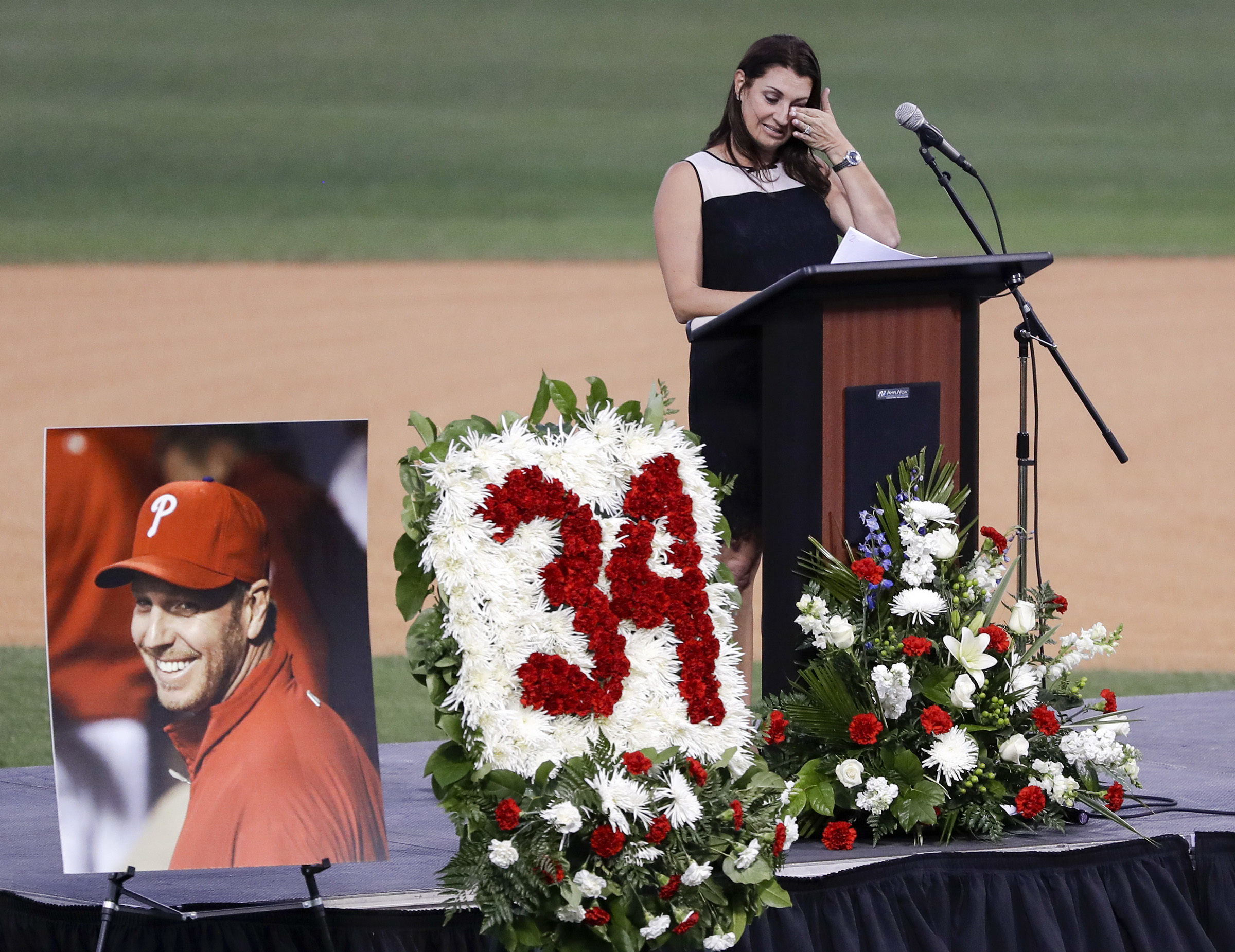 Brandy Halladay, wife of late MLB pitcher Roy Halladay, wipes her eyes while talking about her husband during a Celebration of Life for Roy Halladay at Spectrum Field in Clearwater, Fla., on Tuesday, Nov. 14, 2017. (Yong Kim/Philadelphia Inquirer/TNS)