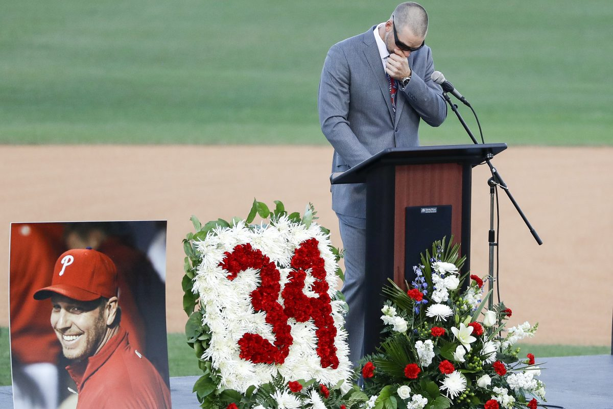 Former MLB pitcher and teammate of Roy Halladay, Chris Carpenter wipes his face during a Celebration of Life for Roy Halladay at Spectrum Field in Clearwater, Florida on Tuesday, November 14, 2017. YONG KIM / Staff Photographer