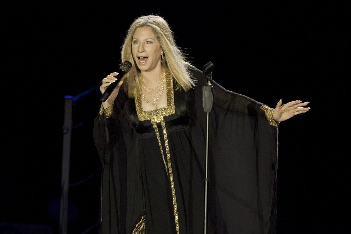"Barbra Streisand performs during a 2103 concert in Tel Aviv, Israel.  On Nov. 22, Netflix will premiere her new concert special, ""Barbra:  The Music… The Mem'ries… The Magic!"""