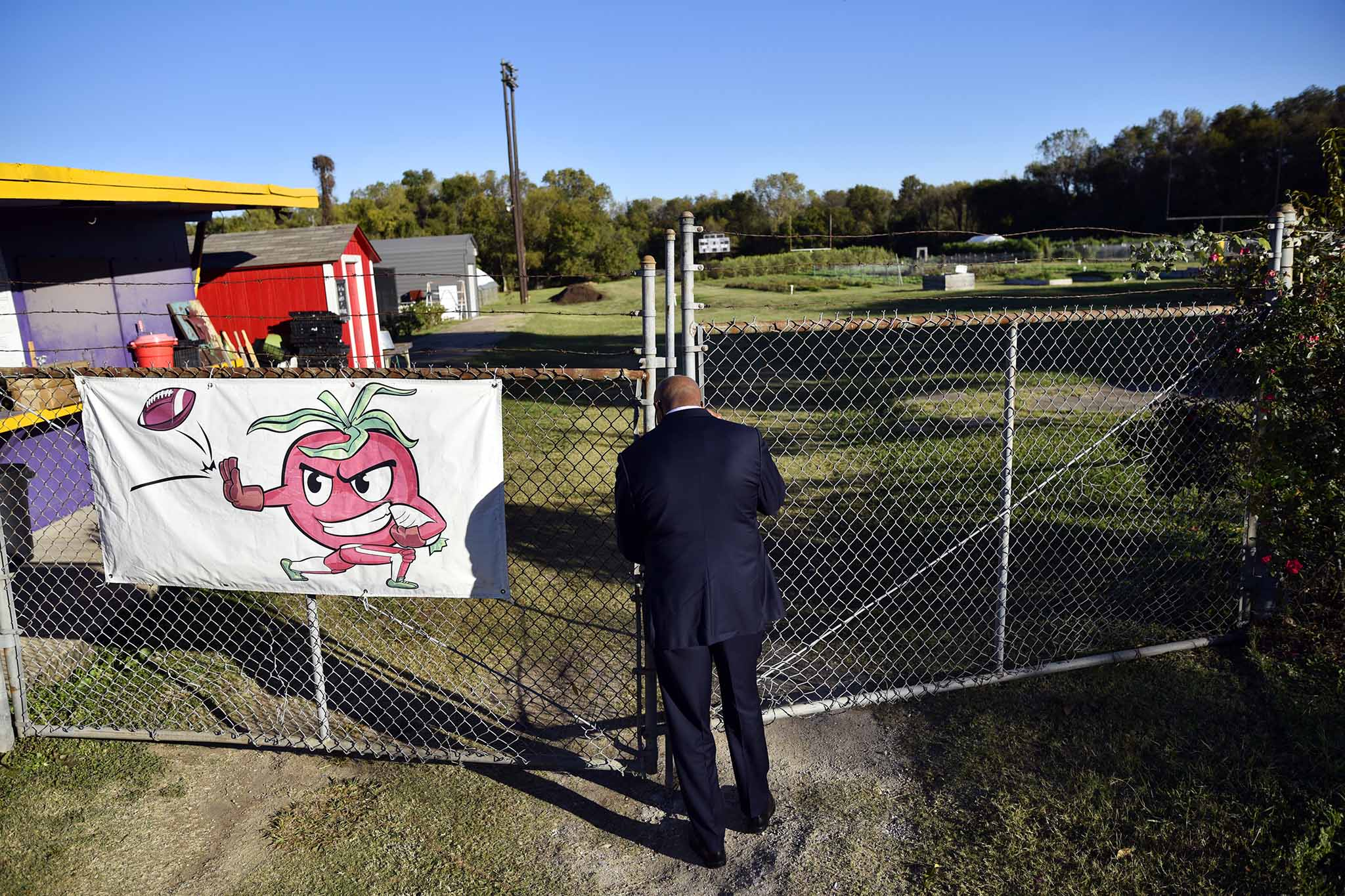 Michael Sorrell, president of Paul Quinn College at entrance to the organic farm on the campus of Paul Quinn College in Dallas, Texas, Tuesday morning, Oct. 24, 2017. The farm used to be the school´s football field until he ended the costly program.