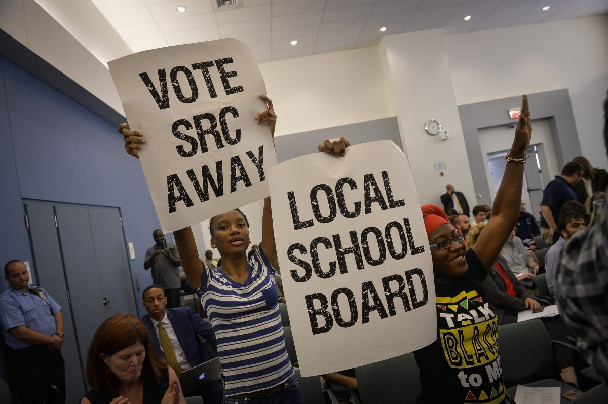 The SRC has proven unpopular during its 16-year history. In this file photo, activists in 2016 called for an end to the commission. The SRC will vote to abolish itself on Thursday.