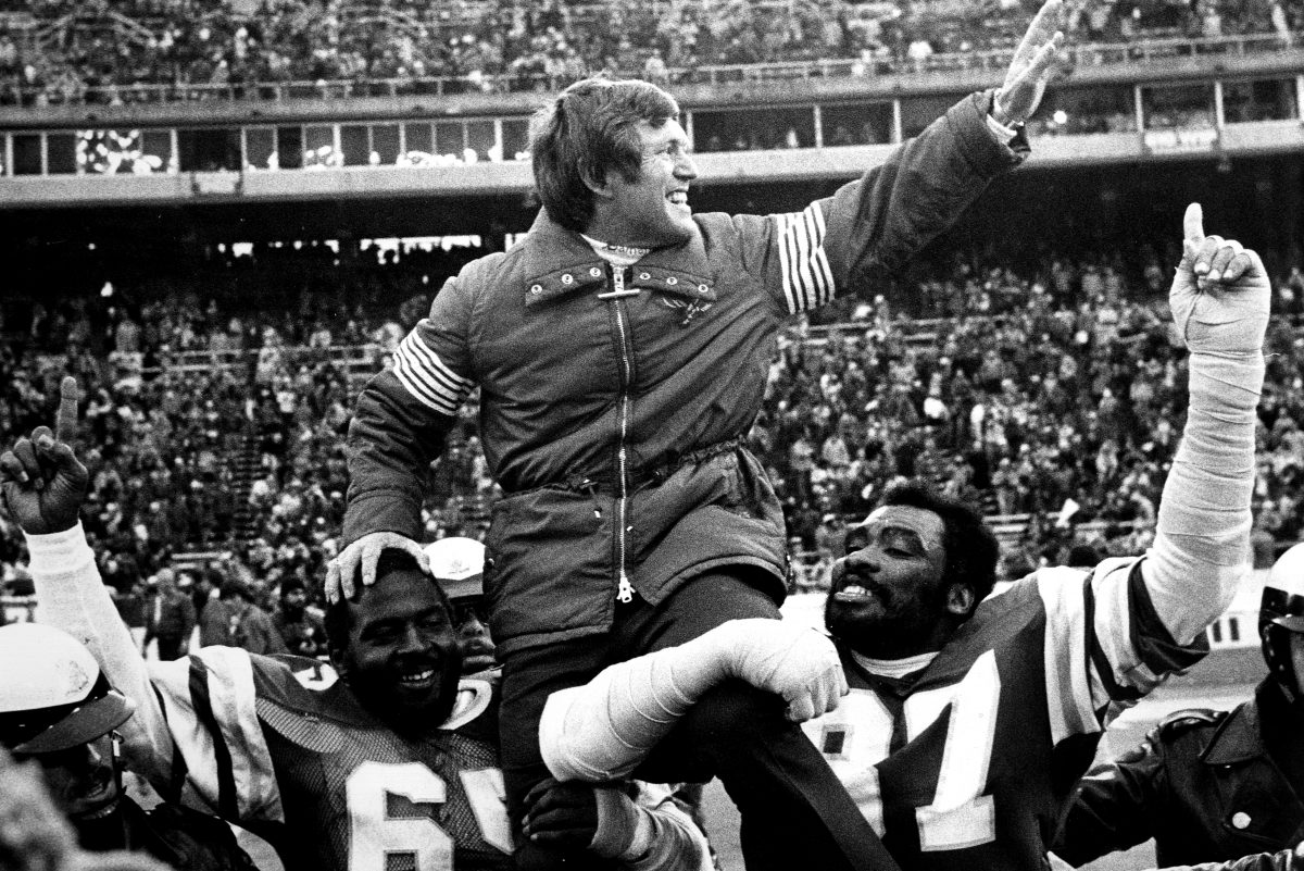 Fomer Eagles coach Dick Vermeil is carried off the field by Charlie Johnson (No. 65) and Claude Humphrey (No. 87) folllowing the team's 1981 NFC championship victory over the Dallas Cowboys.