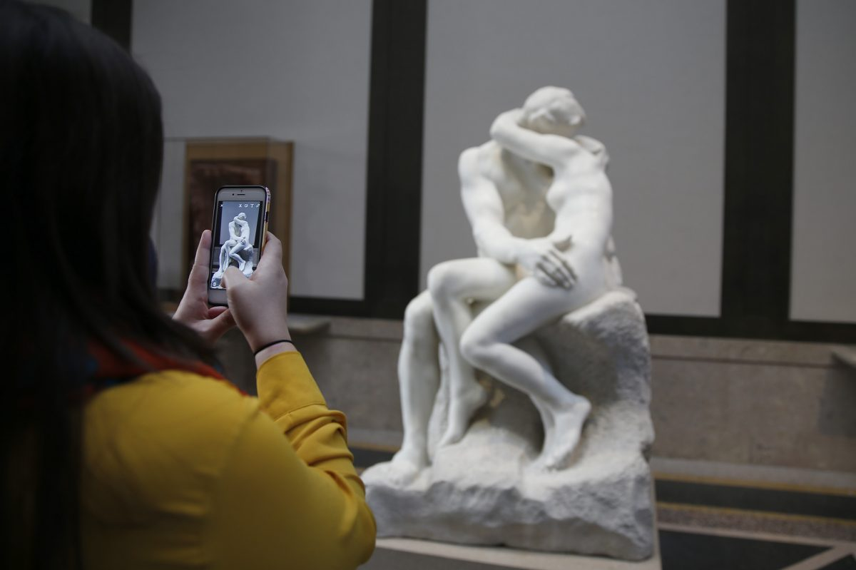 """An unidentified woman photographs a copy of Rodin's """"The Kiss"""" at  the Rodin Museum. The museum unveiled a new exhibition around the theme of passionate embrace early in 2017.  DAVID MAIALETTI / Staff Photographer"""