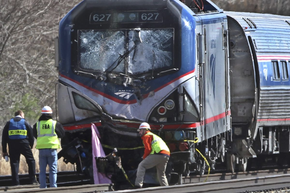FILE – In this April 3 2016, file photo,  investigators inspect the Amtrak train involved in a the deadly crash in Chester, Pa.  which killed two workers and injured 39 passengers. The train struck a backhoe just south of Philadelphia causing a derailment. The National Transportation Safety Board on Tuesday, Nov. 14, 2017, in Washington, was clearly appalled by Amtrak's awful safety culture. (Michael Bryant/The Philadelphia Inquirer via AP, File)