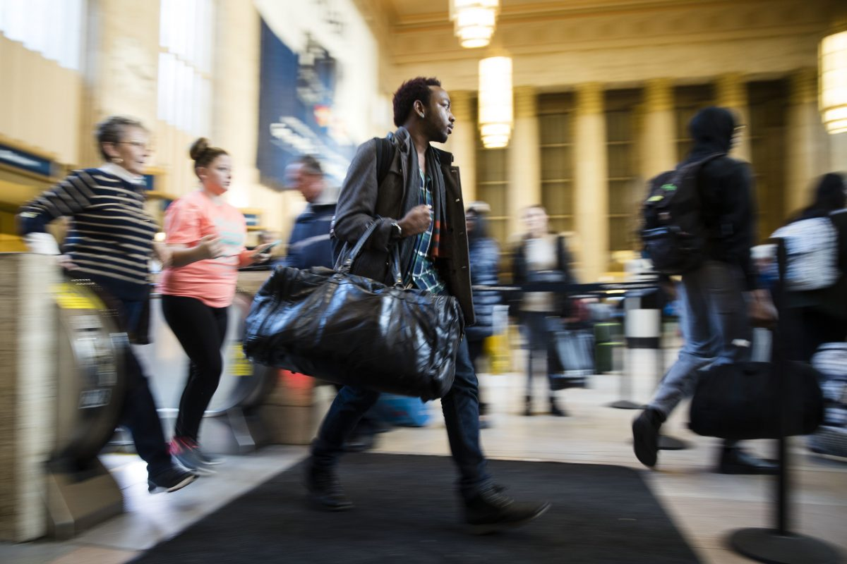 Travelers make their way through 30th Street Station ahead of the Thanksgiving Day holiday last year.