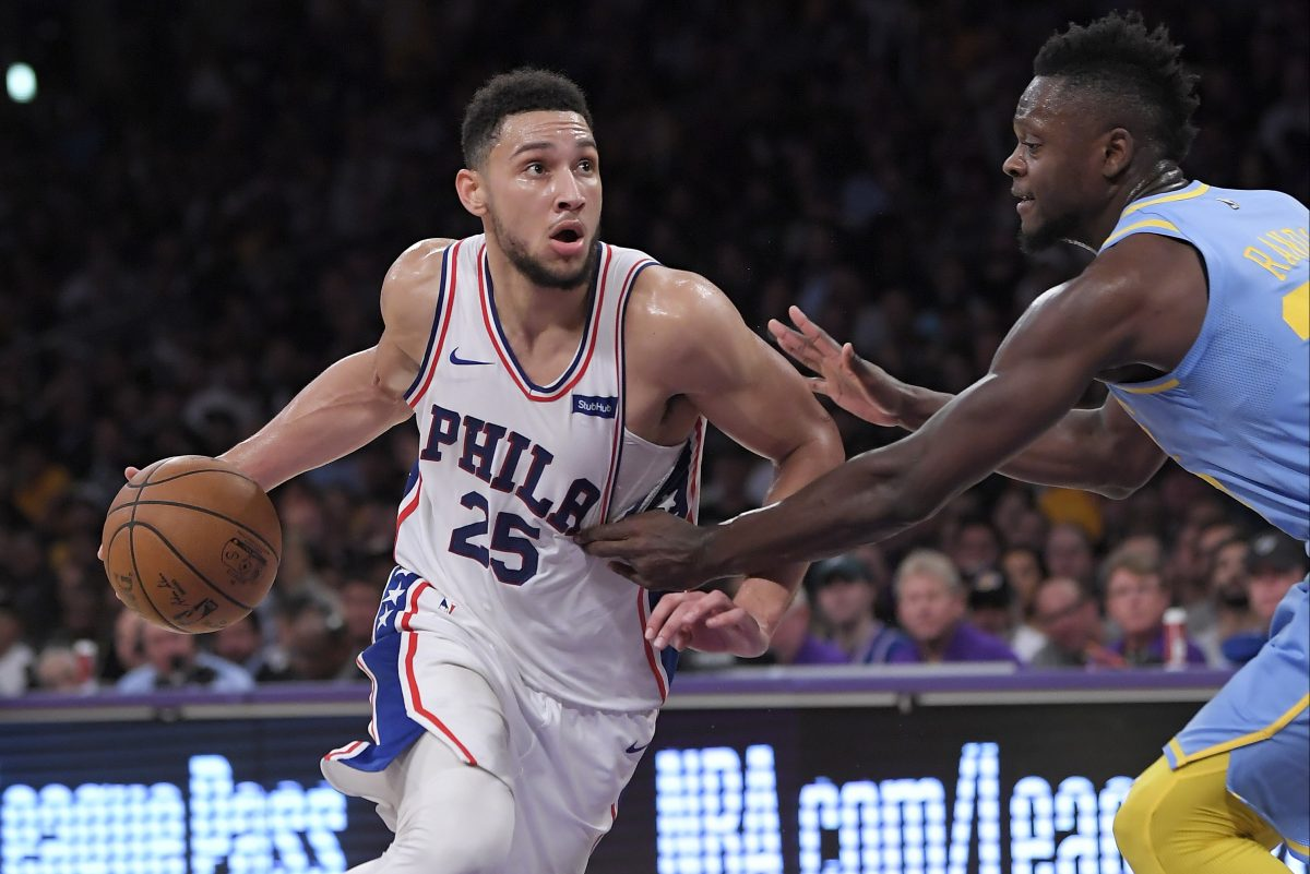 Sixers guard Ben Simmons, left, drives toward the basket as Los Angeles Lakers forward Julius Randle defends during the second half of the Sixers' win on Wednesday.