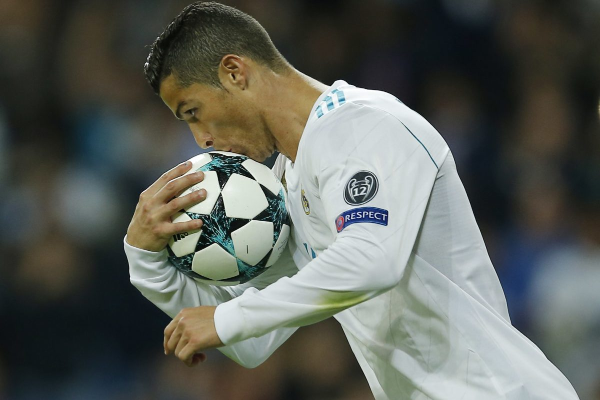 Real Madrid´s Cristiano Ronaldo kisses the ball after scoring a penalty during a Group H Champions League soccer match between Real Madrid and Tottenham Hotspur at the Santiago Bernabeu stadium in Madrid, Tuesday Oct. 17, 2017. (AP Photo/Paul White)