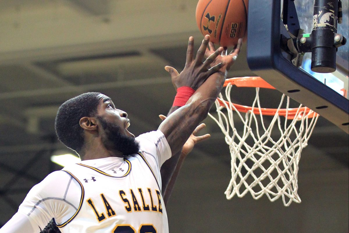 B.J. Johnson of La Salle grabs a rebound in the first half against South Alabama at Tom Gola Arena.