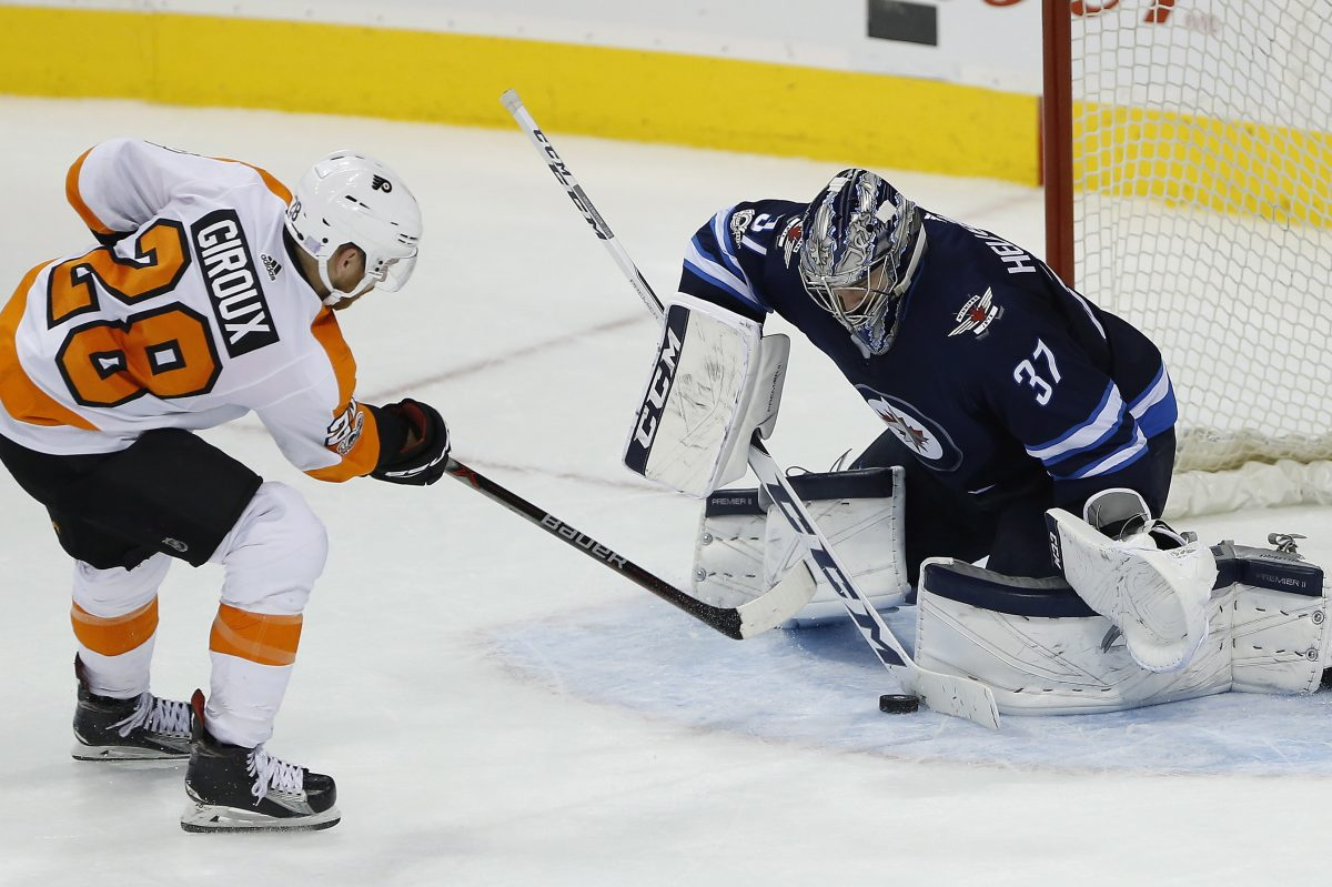 Winnipeg goaltender Connor Hellebuyck stops  Claude Giroux in Thursday's shootout. If Giroux had scored, the Flyers would have won.
