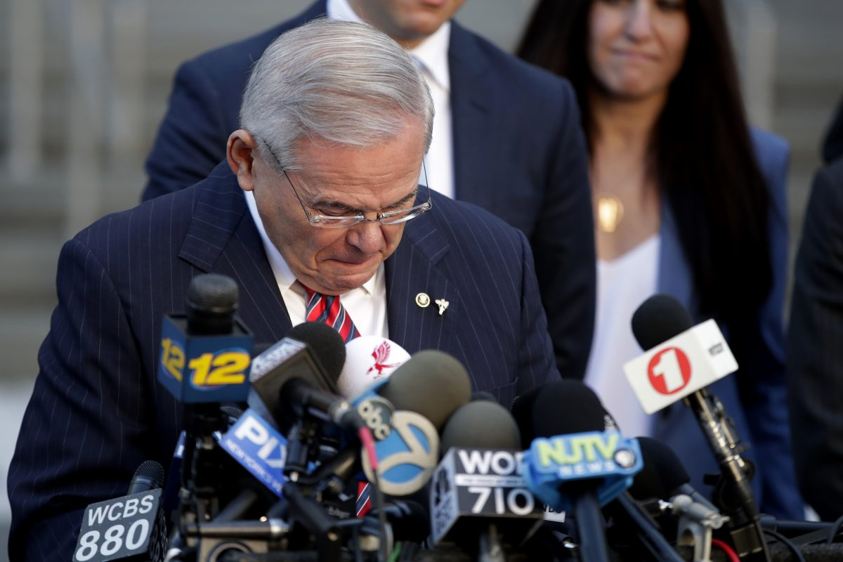 U.S. Sen. Bob Menendez fights tears while speaking to reporters outside Martin Luther King Jr. Federal Courthouse after U.S. District Judge William H. Walls declared a mistrial in Menendez's federal corruption trial, Thursday, Nov. 16, 2017, in Newark, N.J. (AP Photo/Julio Cortez)