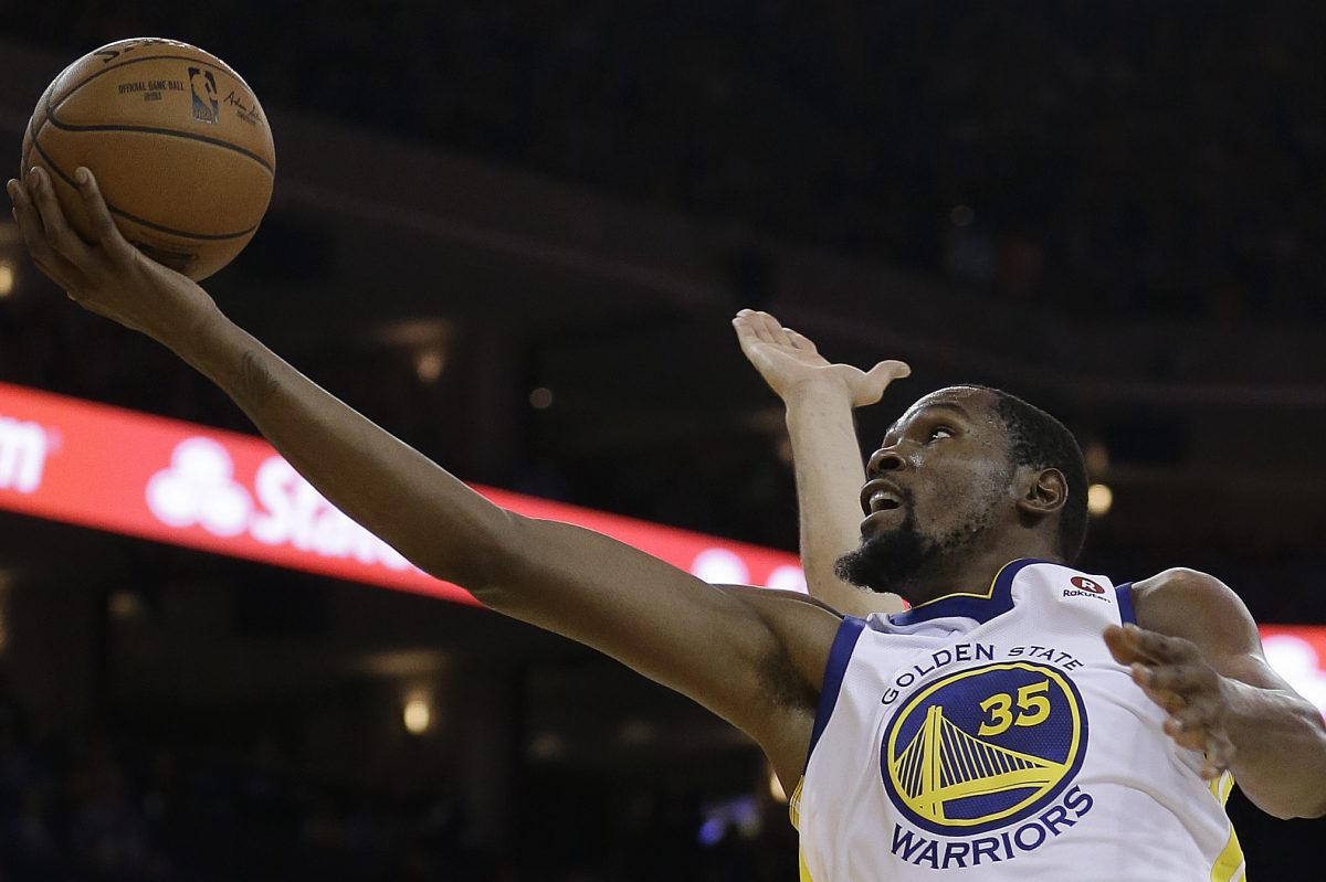 Warriors forward Kevin Durant lays up a shot against the Sixers on Saturday, Nov. 11.