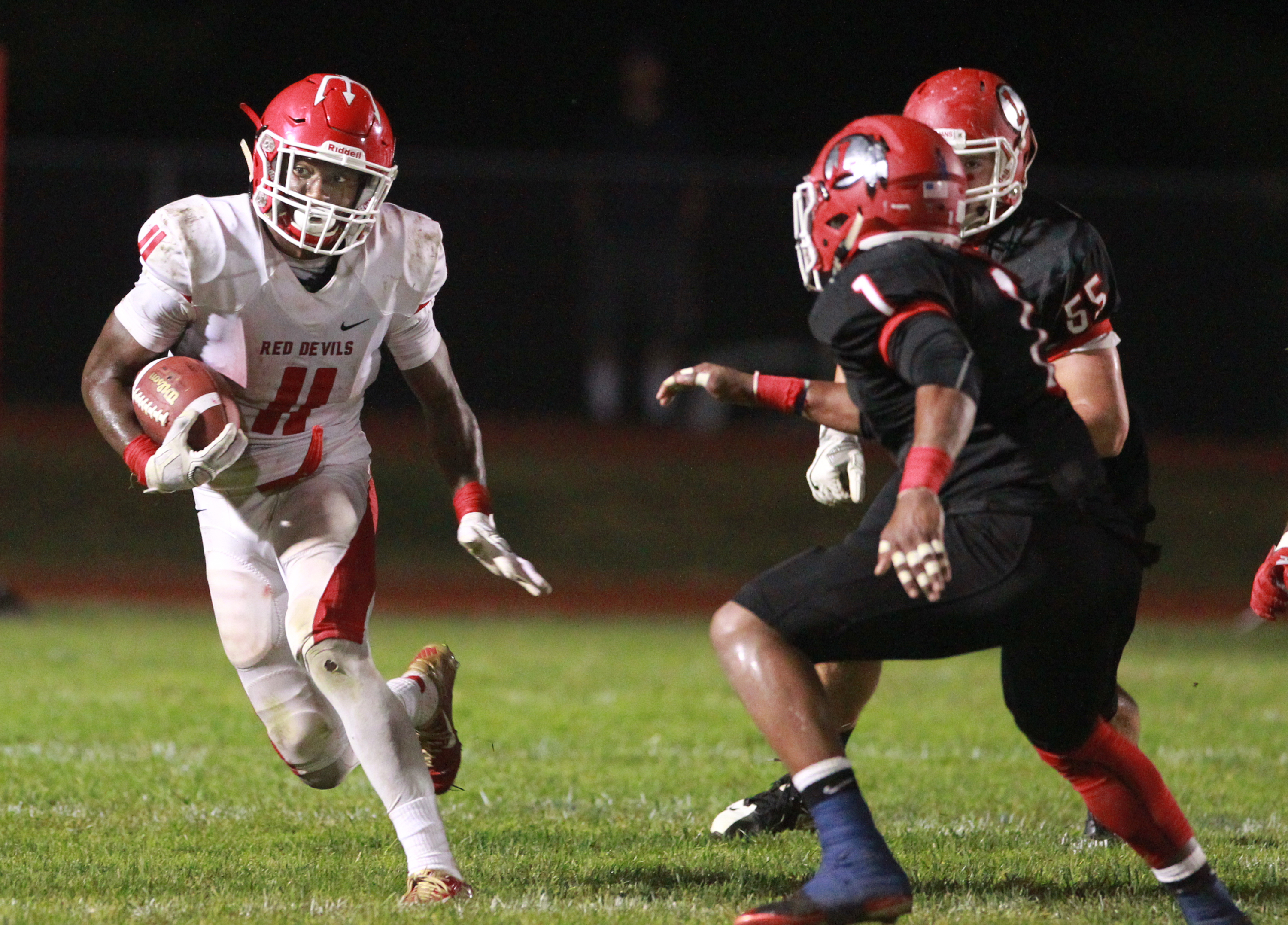 Iverson Clement, left, of Rancocas Valley runs against Lenape in October.