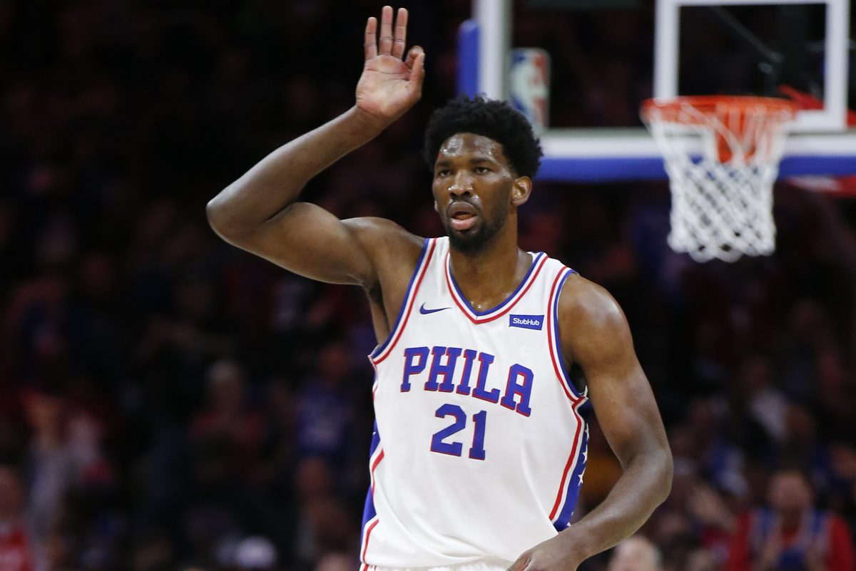 Sixers center Joel Embiid raises his hand after making a three-point basket against the Golden State Warriors on Saturday.