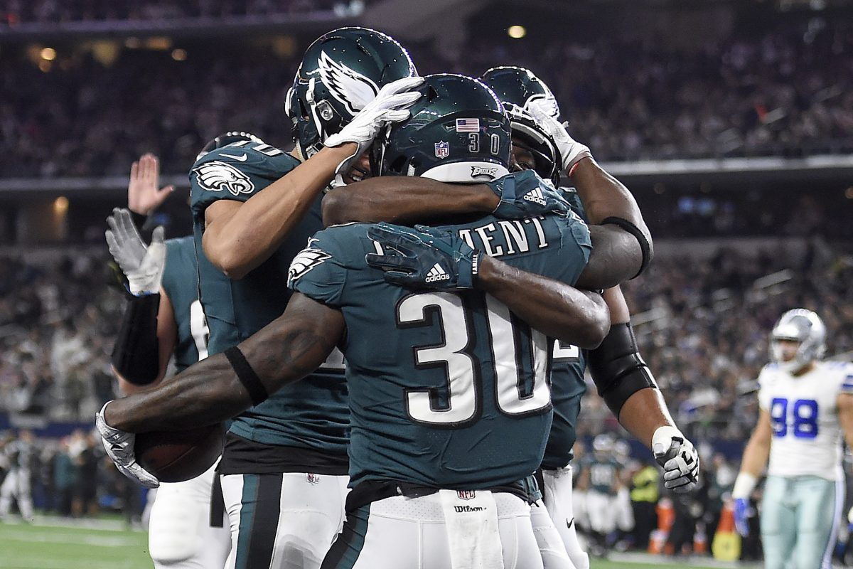 Eagles' Corey Clement, center, celebrates with his teammates after scoring a two-point conversion.