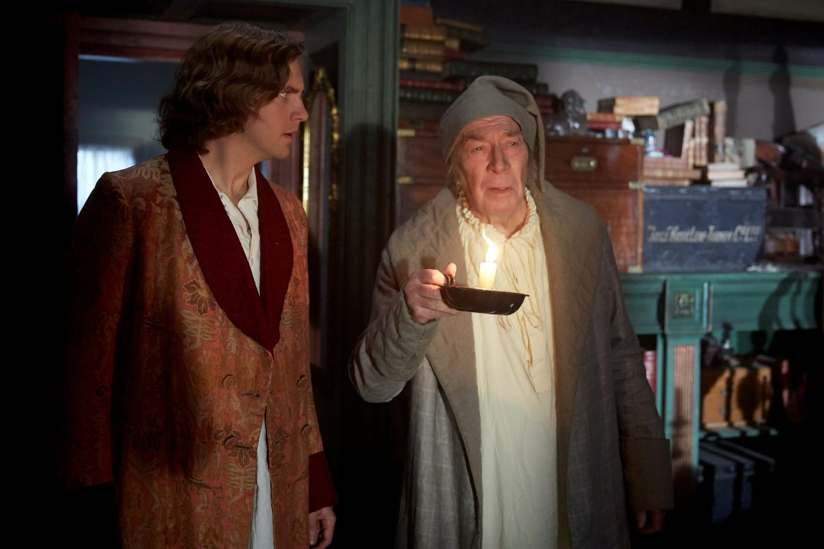 Dan Stevens and Christopher Plummer in 'The Man Who Invented Christmas.'