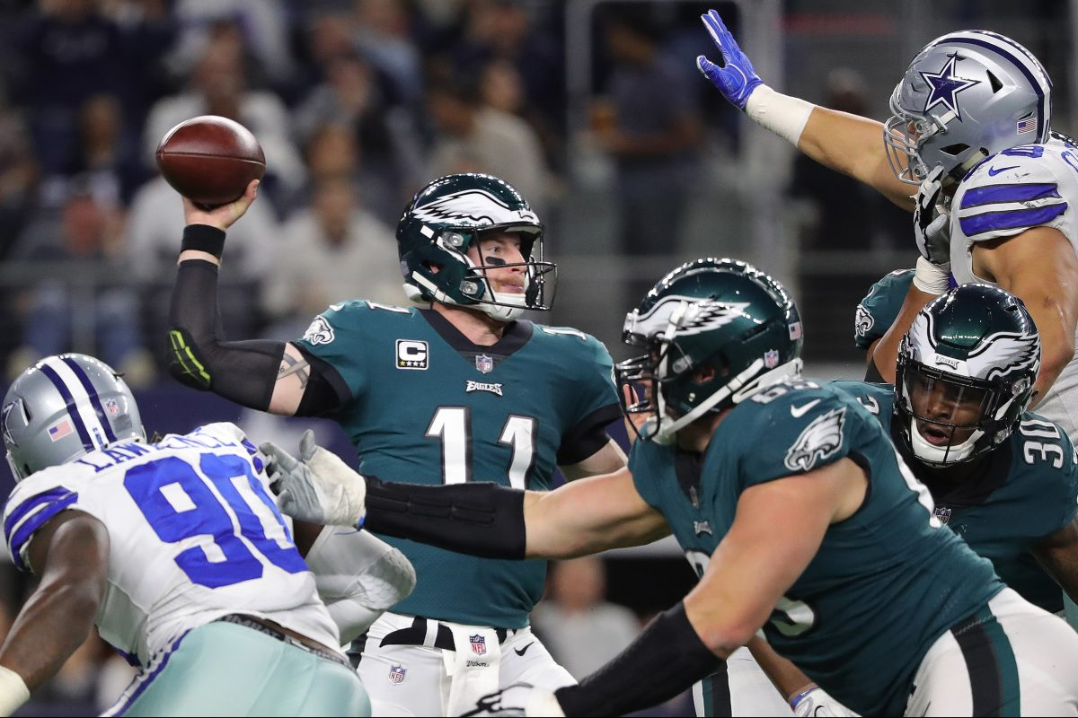 Eagles' Carson Wentz, left, throws during the 2nd quarter as the Philadelphia Eagles play the Dallas Cowboys in Arlington, Texas on November 19, 2017.