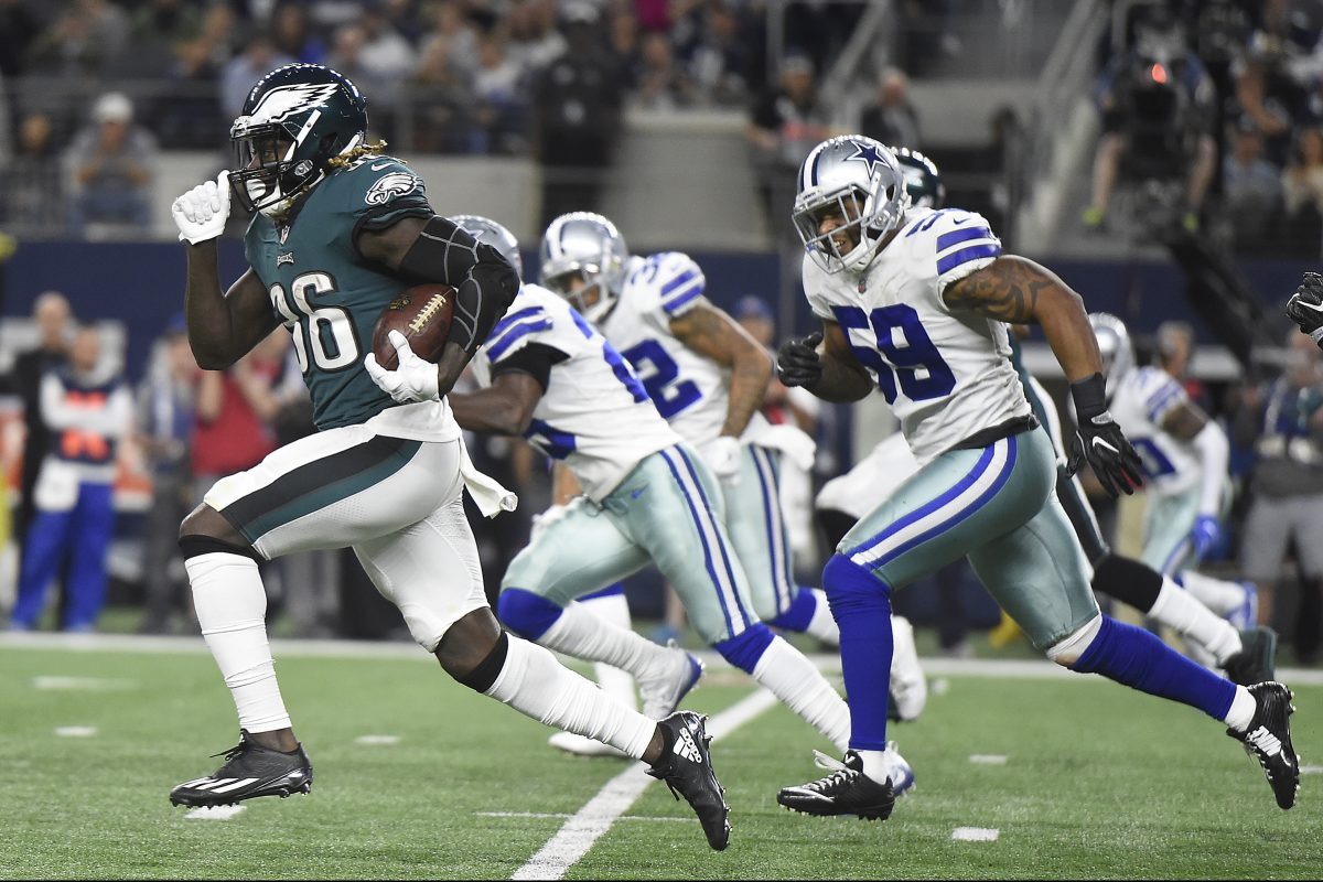 Jay Ajayi, left, leaves a host of Cowboys defenders in his dust during a third-quarter run Sunday night.