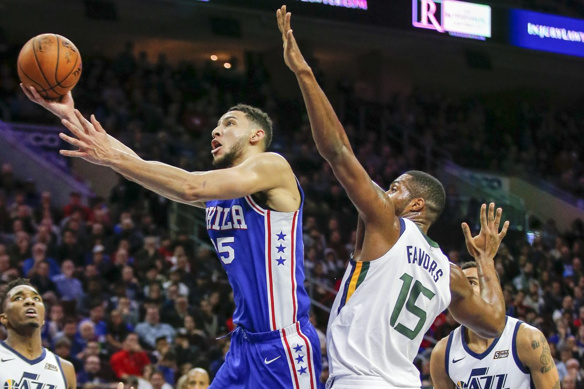 Sixers guard Ben Simmons drives to the basket past Utah Jazz forward Derrick Favors during the third quarter.