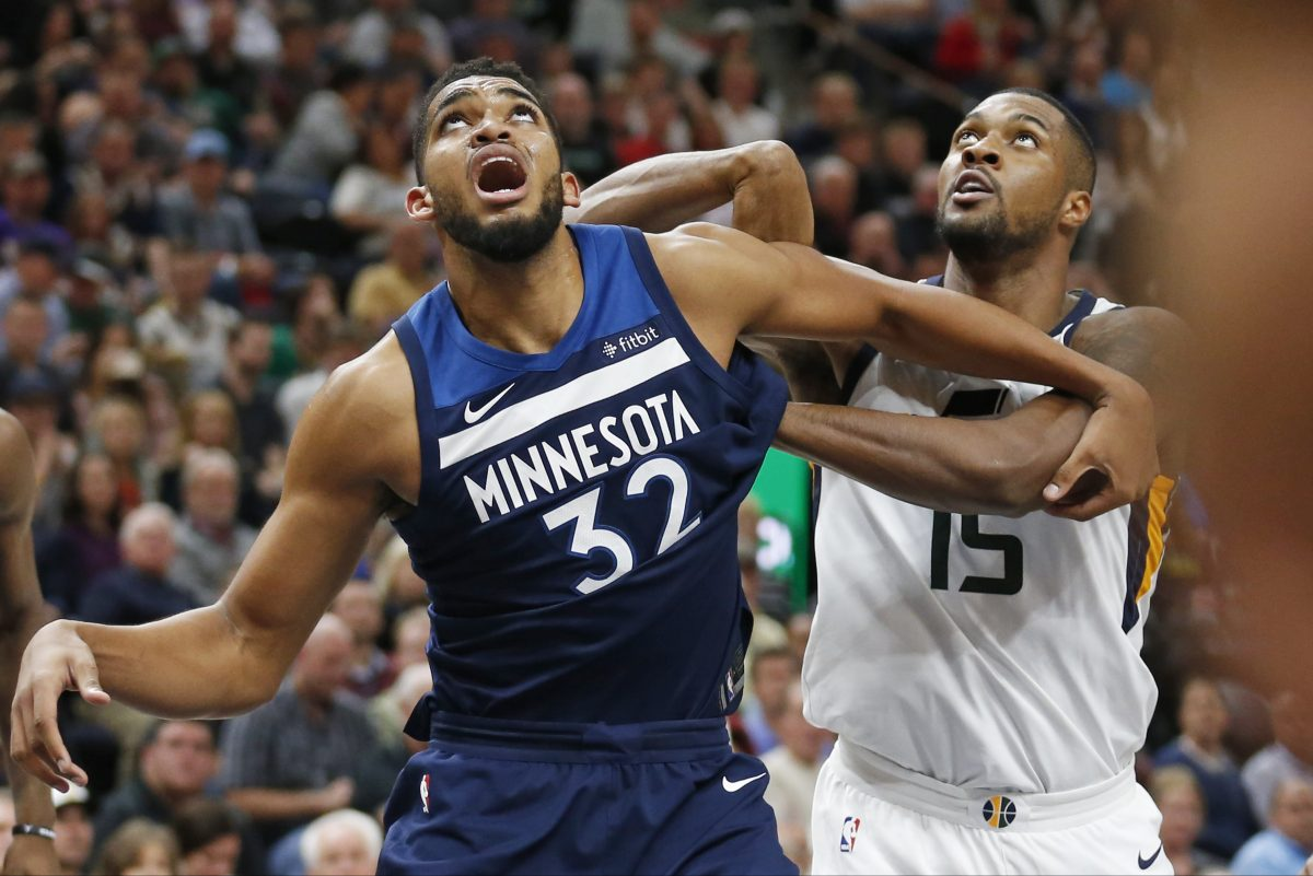 Jazz forward Derrick Favors, here battling for a rebound with Minnesota center Karl-Anthony Towns (32), will draw the defensive assignment on Joel Embiid if the Sixers center plays.