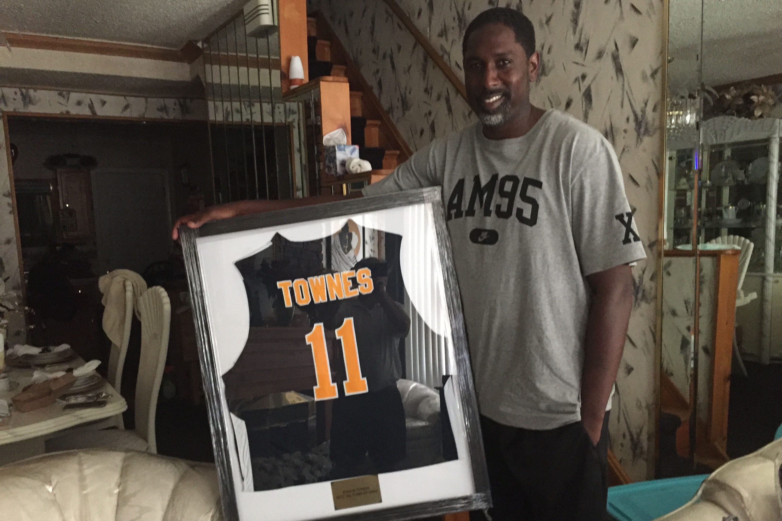 Kareem Townes holds up his framed La Salle jersey.