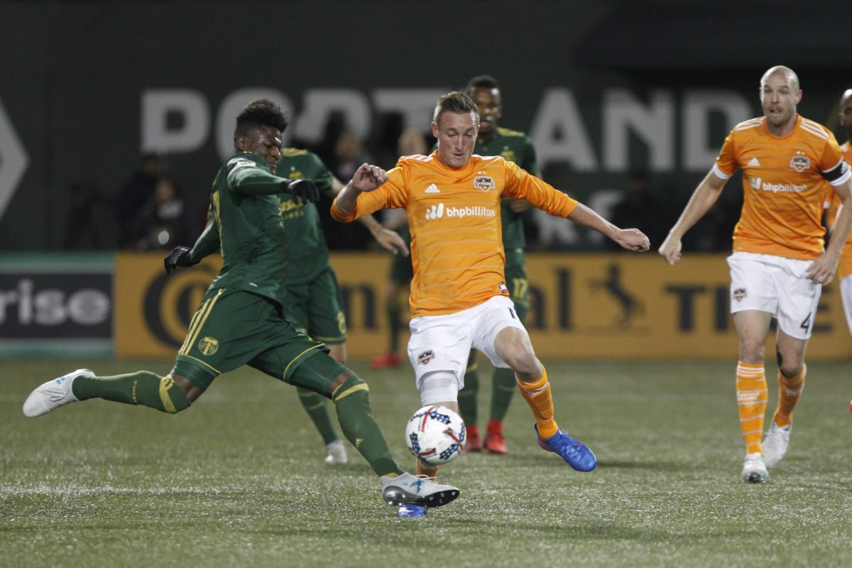 The Houston Dynamo upset the No. 1 seed Portland Timbers to reach Major League Soccer's Western Conference final.