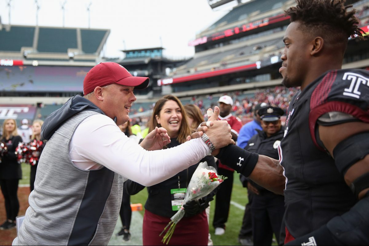Temple head coach Geoff Collins greets Temple defensive lineman Jacob Martin (9) during the senior day ceremony before a game against UCF at Lincoln Financial Field on Saturday, Nov 18, 2017. TIM TAI / Staff Photographer