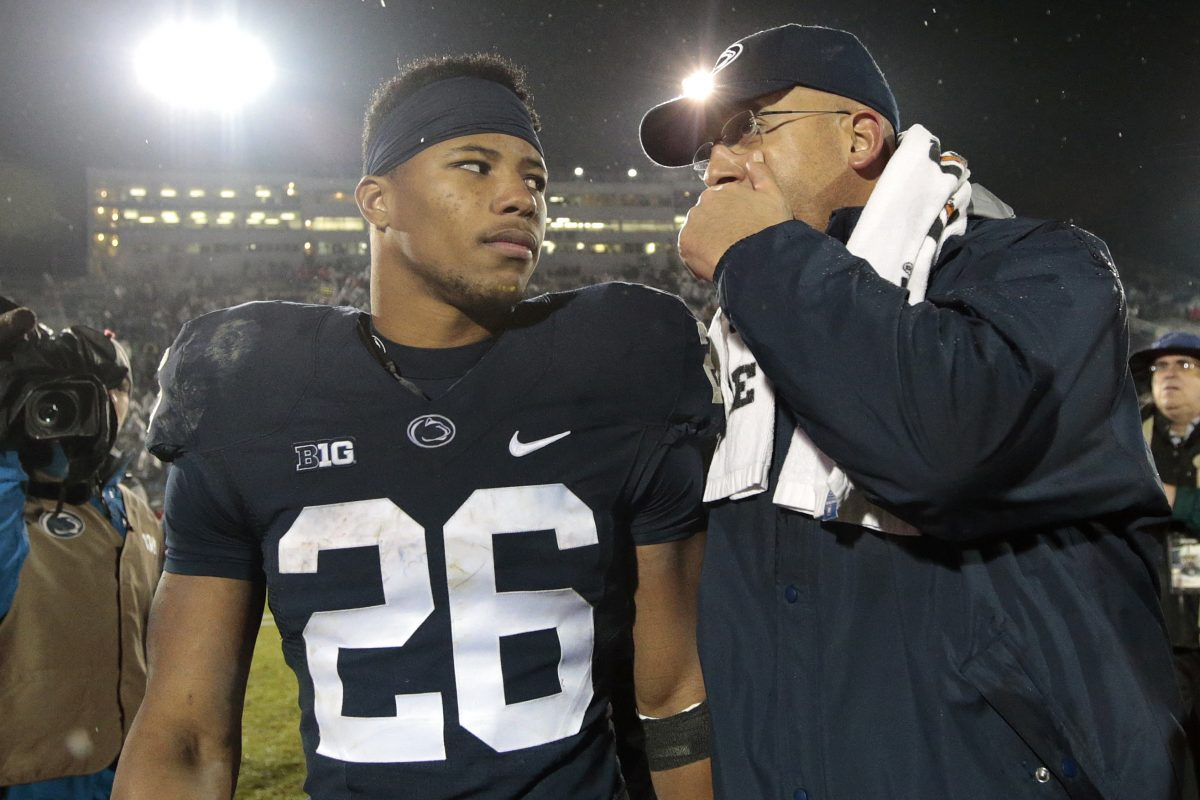 Saquon Barkley (26) walks off the field with coach James Franklin after the victory over Nebraka.