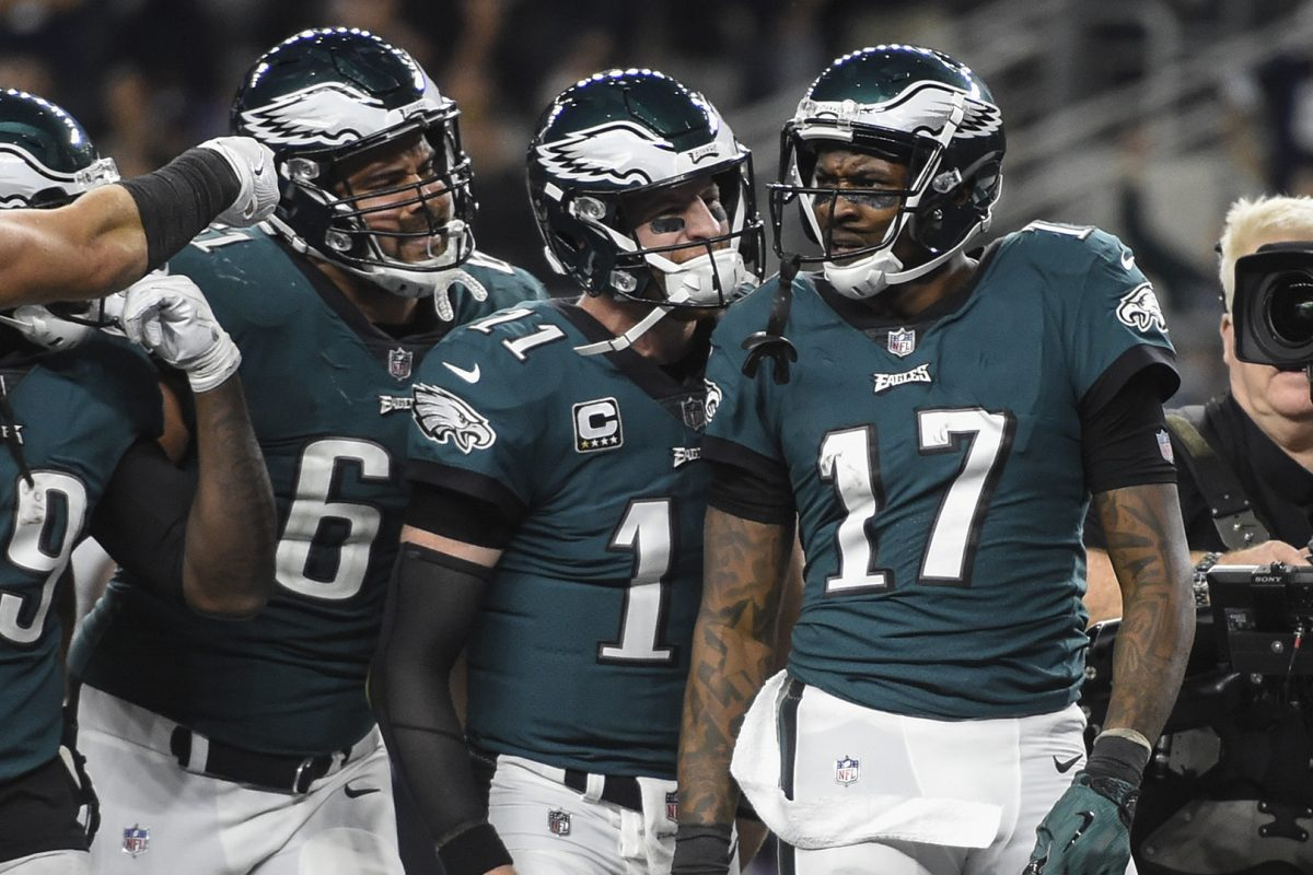 Eagles wide receiver Alshon Jeffery (17) celebrates with teammates after scoring a touchdown  against the Cowboys.