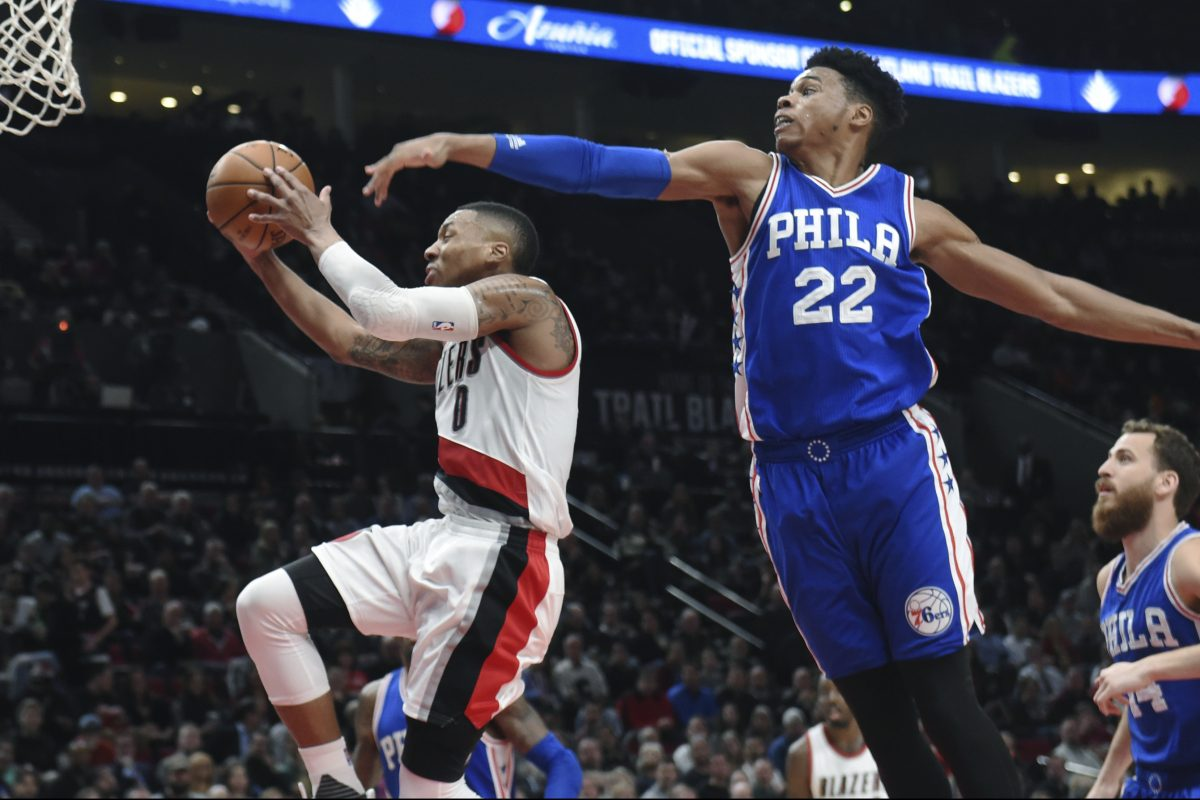 Portland Trail Blazers guard Damian Lillard drives to the basket against Philadelphia 76ers forward Richaun Holmes during the fourth quarter of an NBA basketball game in Portland, Ore., Thursday, March 9, 2017. The Blazers won 114-108 in overtime. (AP Photo/Steve Dykes)