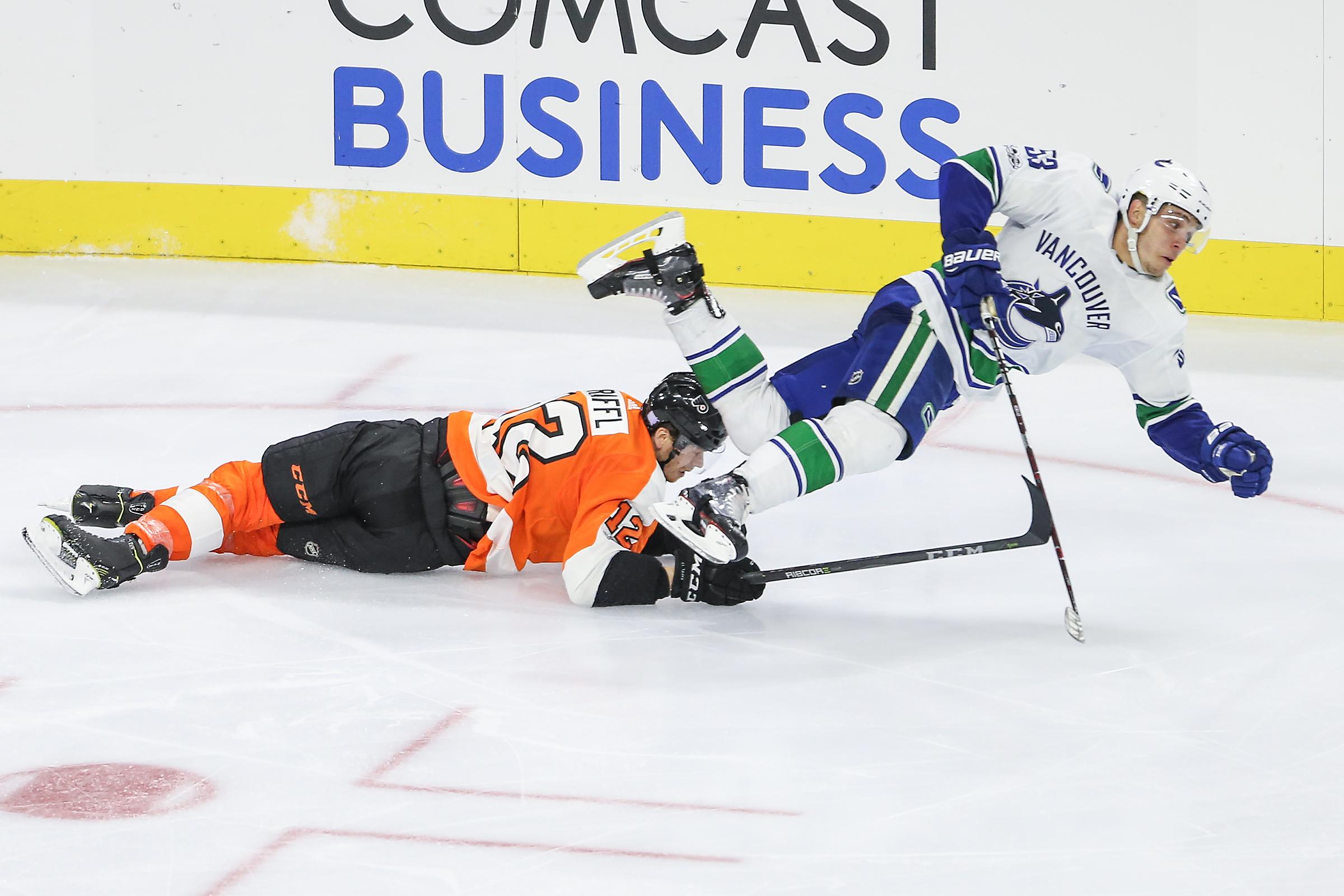 Flyers´ Michael Raffl trips Canucks´ Bo Horvat during the third period at the Wells Fargo Center in Philadelphia,.Tuesday, November 21, 2017. Canucks beat the Flyers 5-2. STEVEN M. FALK / Staff Photographer