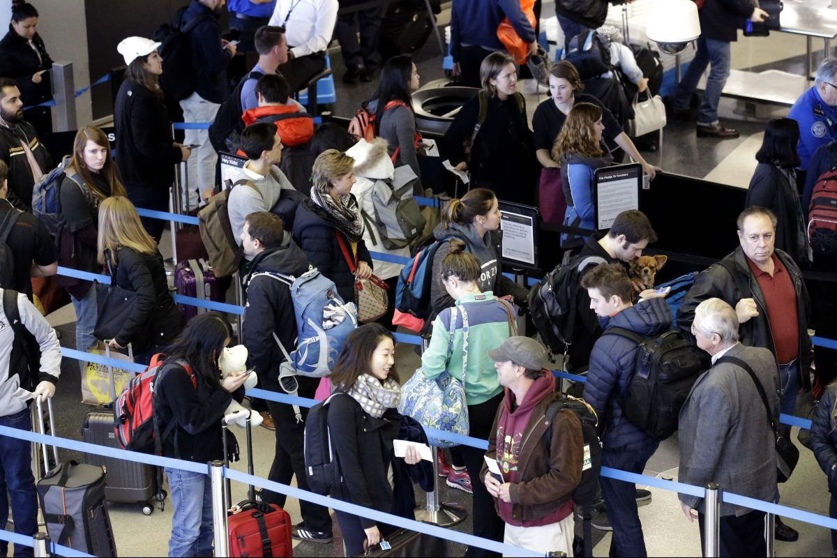 In this Nov. 29, 2015, file photo, travelers line up at a security checkpoint area in Terminal 3 at O´Hare International Airport in Chicago.