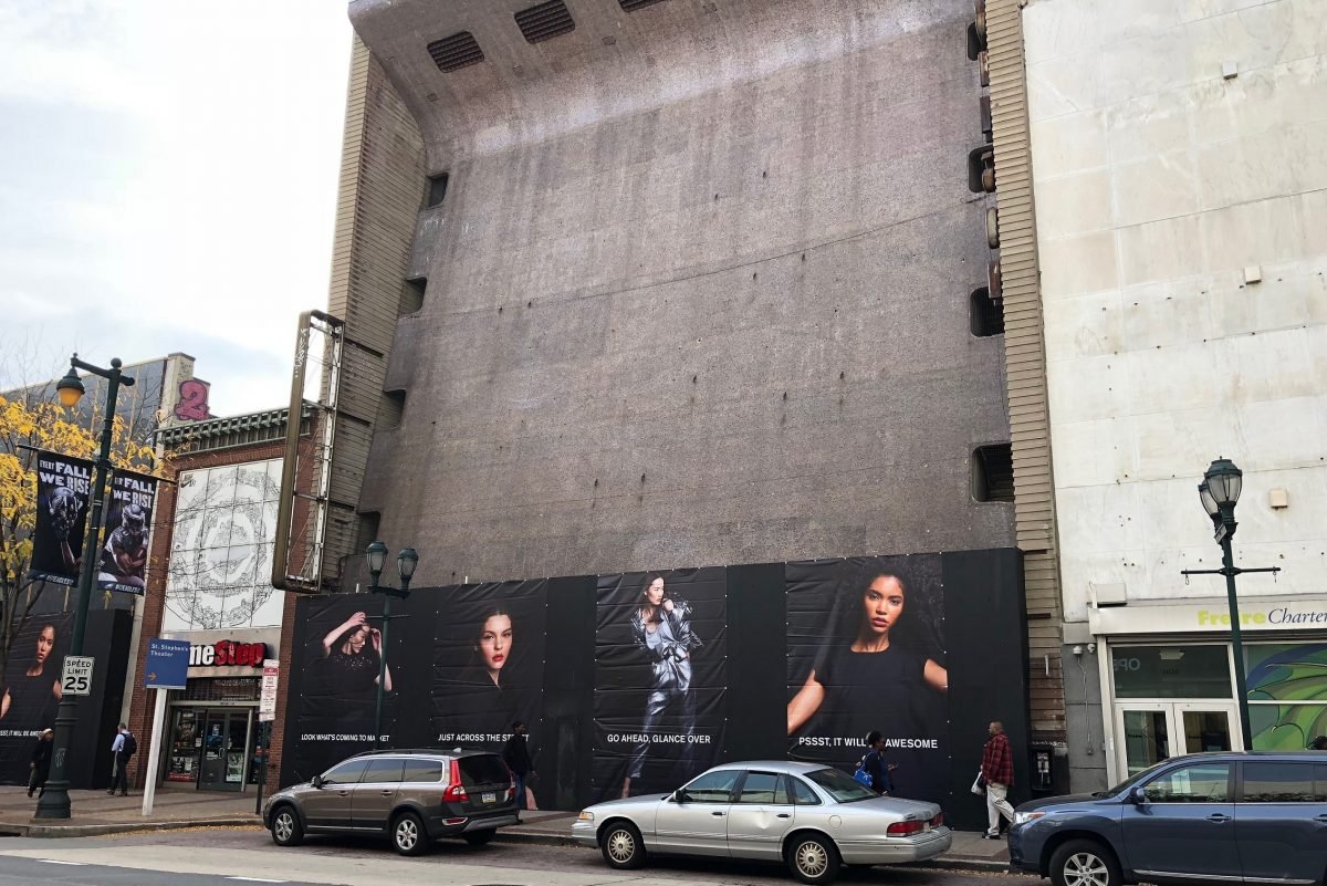 The former Robinson department store building at 1020 Market St. behind billboards advertising the Fashion District Philadelphia project across the street.