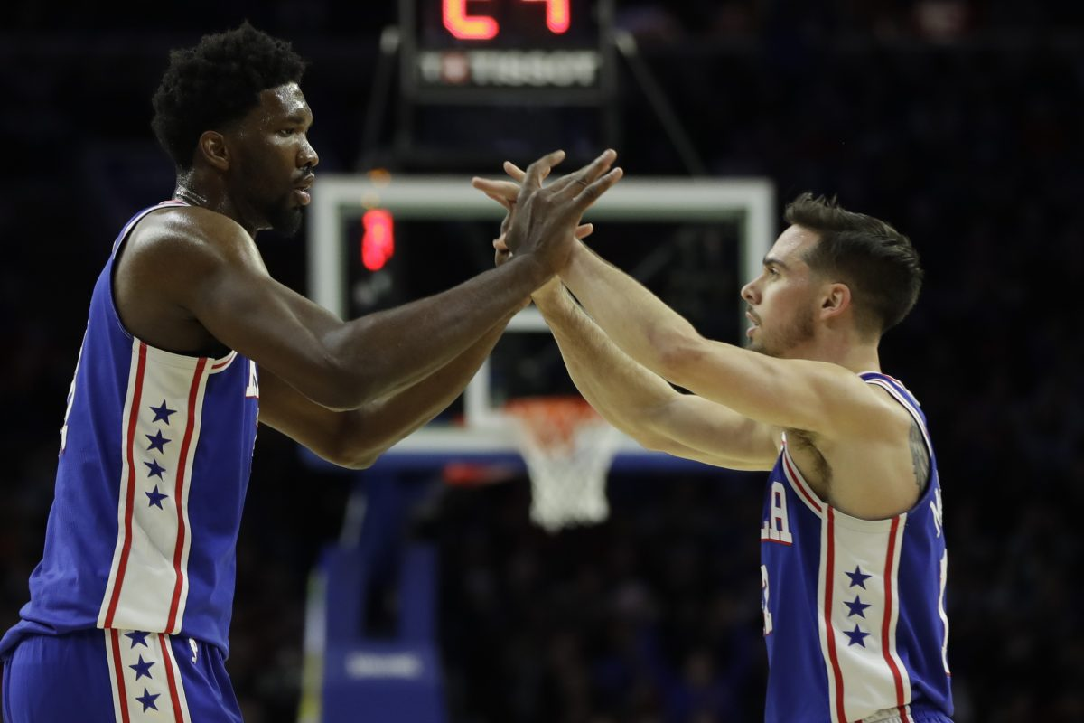 The 76ers´ Joel Embiid, left, and T.J. McConnell celebrate during a win against the Portland Trail Blazers.